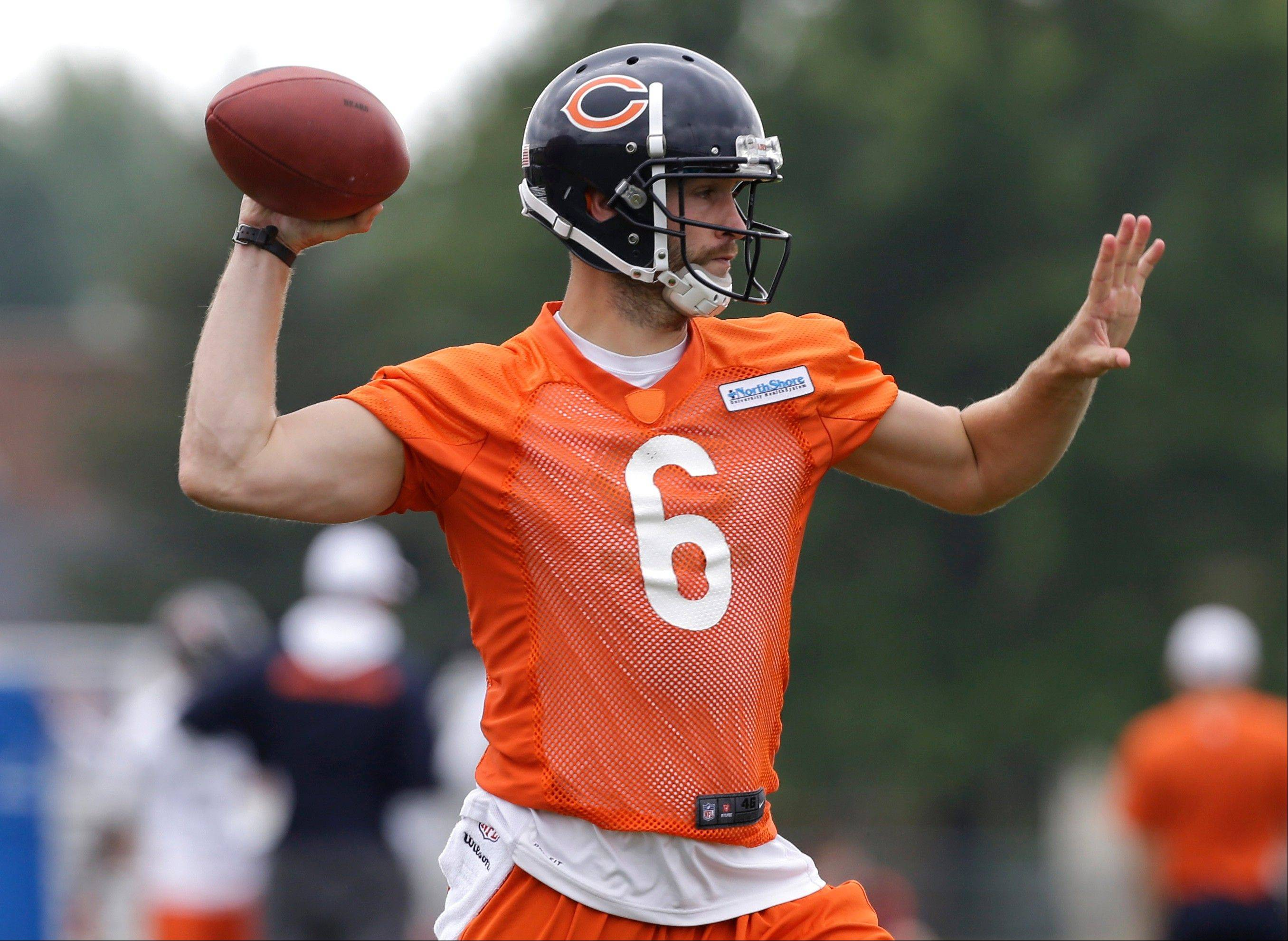 Jay Cutler looks to a pass during NFL football training camp Saturday, July 27, 2013, at Olivet Nazarene University in Bourbonnais.