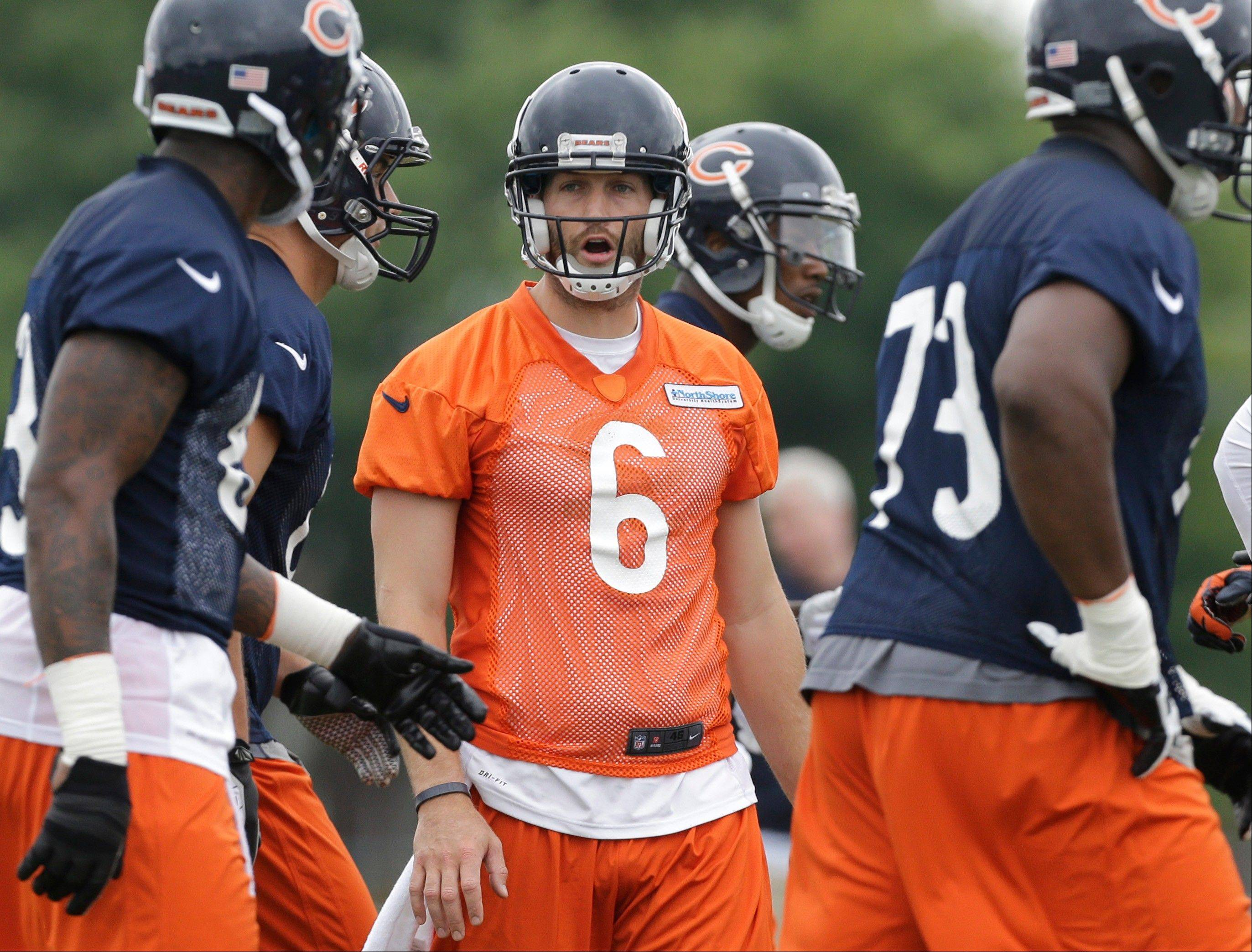 Chicago Bears quarterback Jay Cutler (6) talks to teammates during NFL football training camp Saturday, July 27, 2013, at Olivet Nazarene University in Bourbonnais.