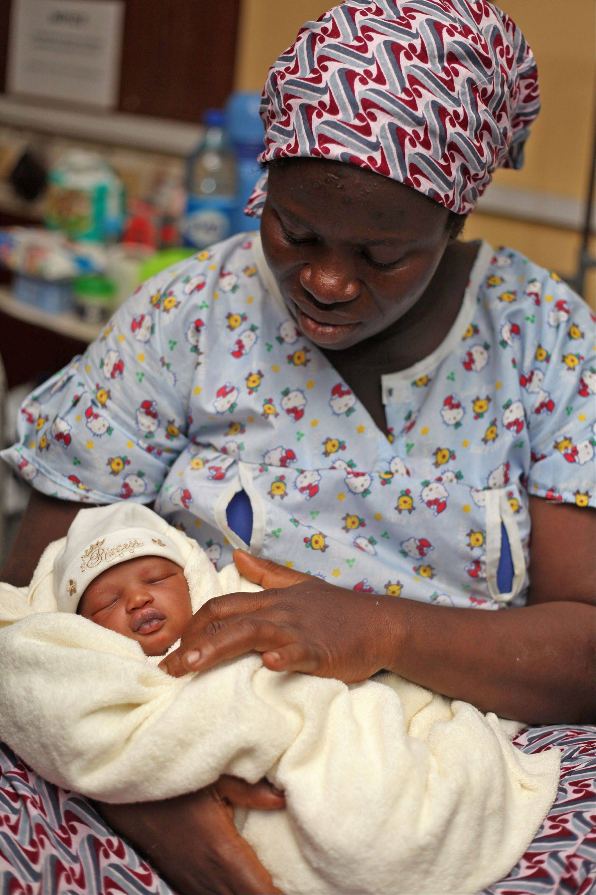 "Naimot Alabi holds her yet-to-be named baby son born July 22 in the Lagos Island Maternity Home, in Lagos, Nigeria. ""I want a better life for him,"""