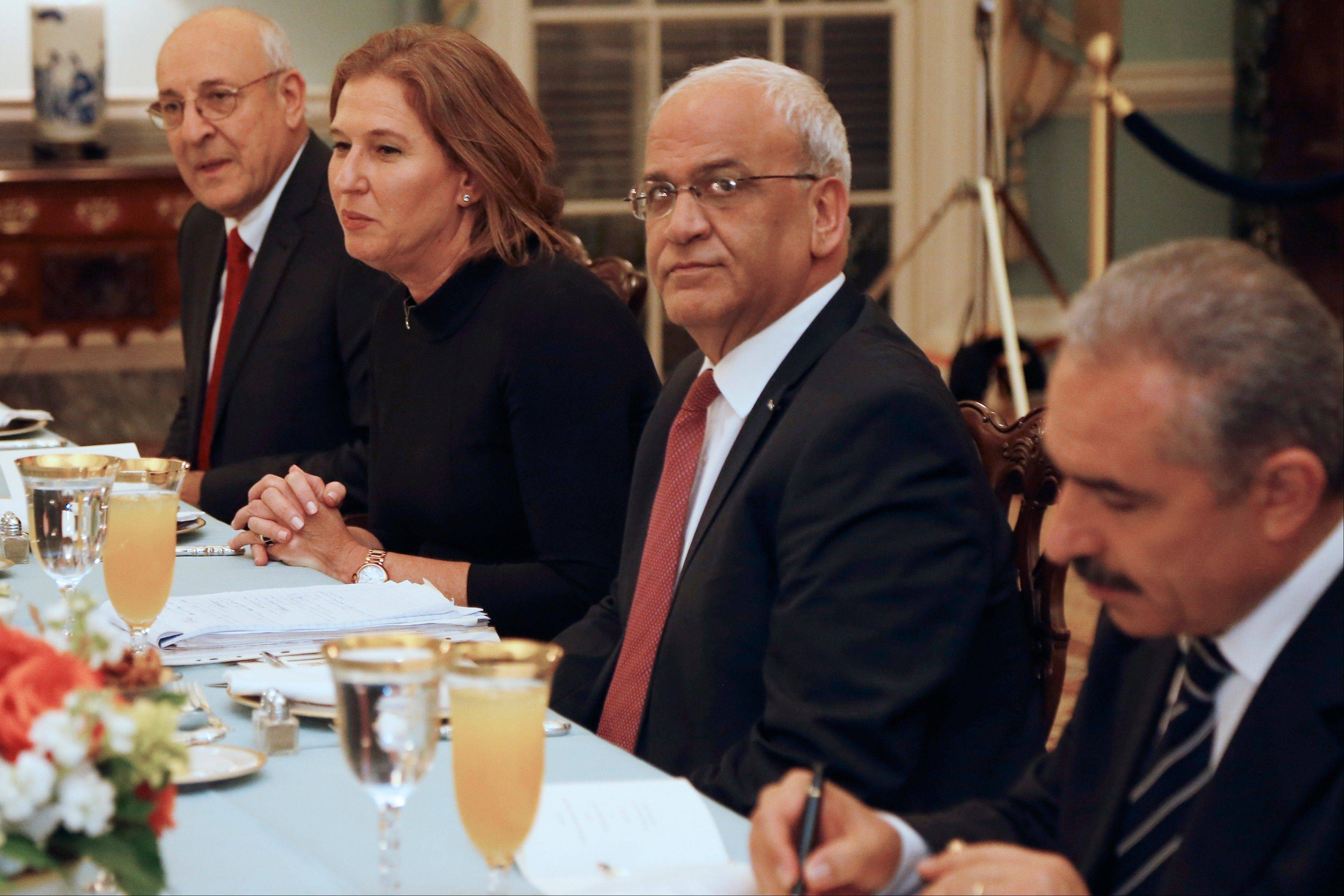 Israel�s Justice Minister and chief negotiator Tzipi Livni, second from left, Palestinian chief negotiator Saeb Erekat, second right, Yitzhak Molcho, an adviser to Israeli Prime Minister Benjamin Netanyahu, left, and Mohammed Shtayyeh, aide to Palestinian President Mahmoud Abbas, right, attend an Iftar dinner, which celebrates Ramadan, hosted by Secretary of State John Kerry at the State Department Monday.