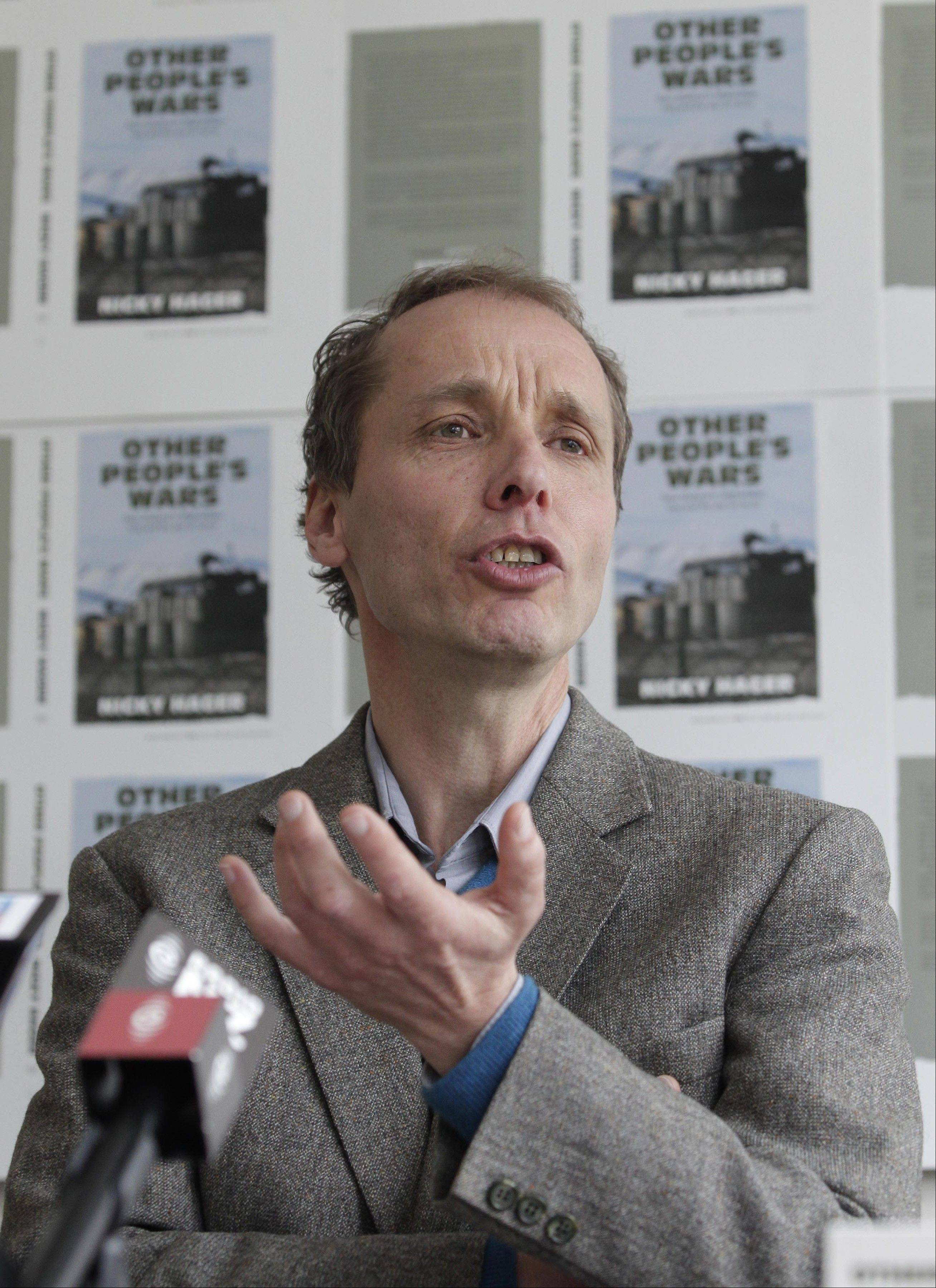 In this Sept. 1, 2011 photo, author Nicky Hager speaks during a news conference in Wellington. A report in the Sunday Star-Times newspaper said that the New Zealand military, assisted by U.S. spy agencies, collected phone metadata to monitor New Zealand�s journalist Jon Stephenson. New Zealand said Monday, July 29, 2013, there is no evidence that either the U.S. or the New Zealand military spied on journalist Stephenson in Afghanistan who was freelancing for American news organization McClatchy.