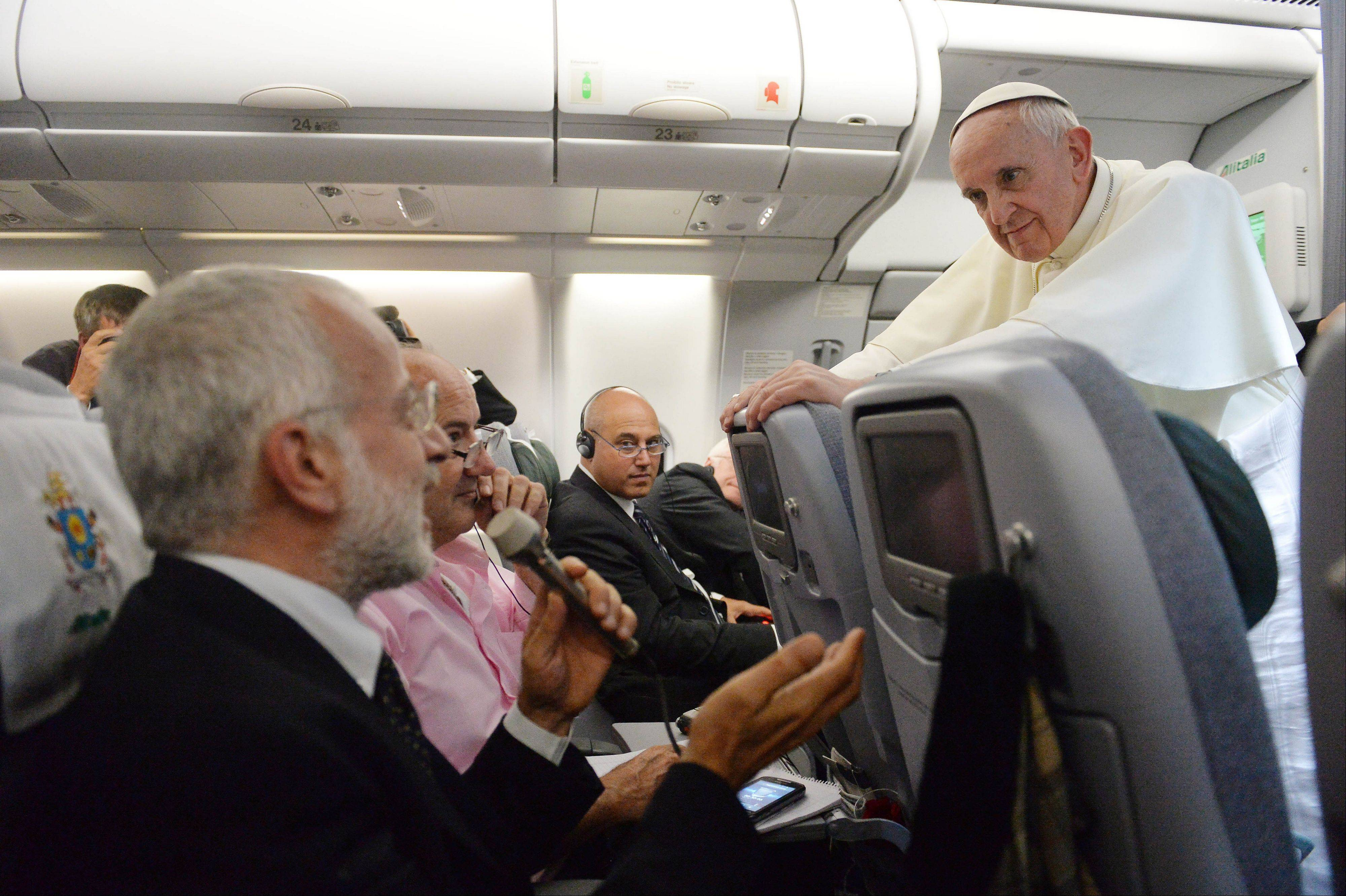 Pope Francis, answering questions during a news conference aboard the papal flight on its way back from Brazil Monday, reached out to gays on Monday, saying he wouldn't judge priests for their sexual orientation.