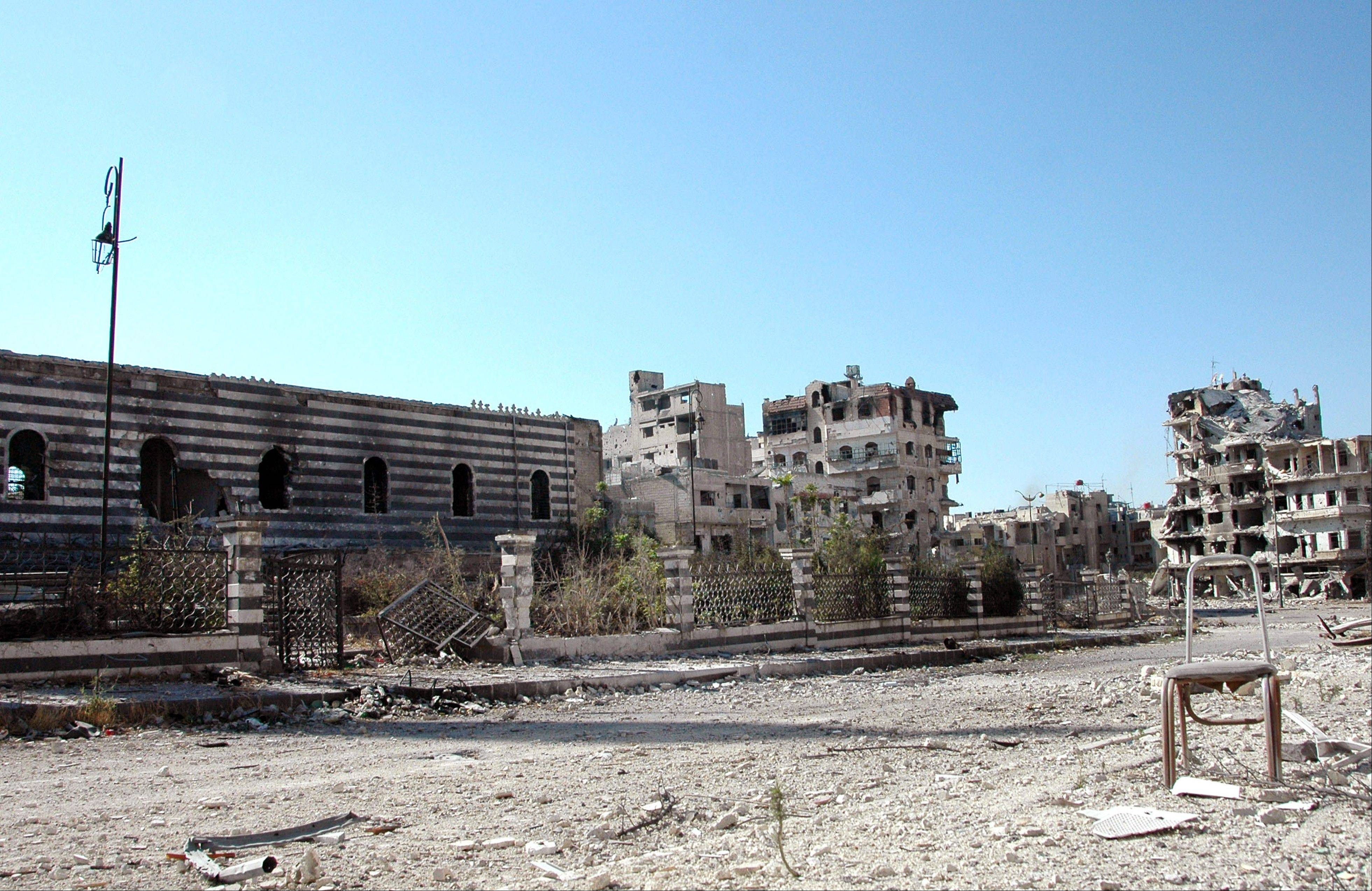 Syrian government forces captured a historic mosque in the central city of Homs on Saturday, expelling rebel forces who had been in control of the 13th-century landmark for more than a year and dealing a symbolic blow to opposition forces.