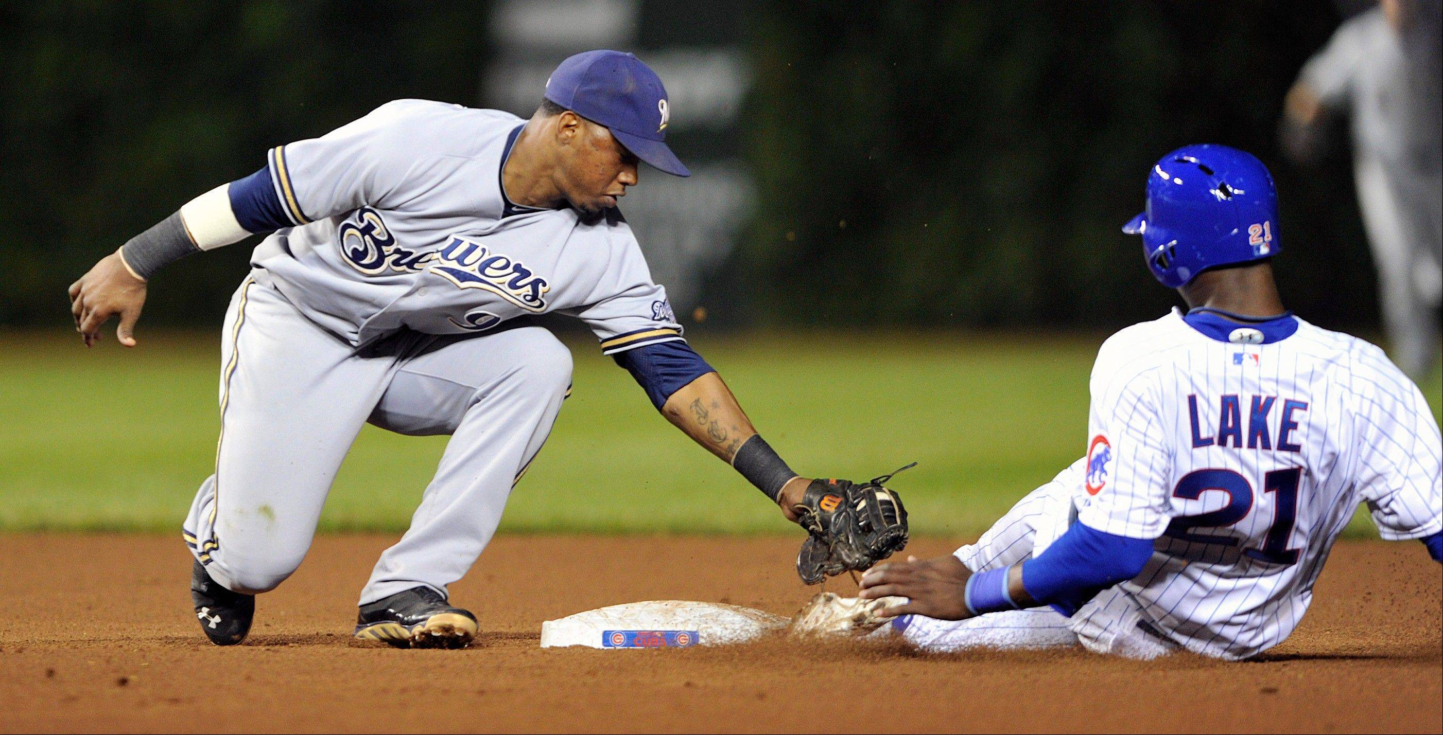 The Milwaukee Brewers' Jean Segura tags out the Cubs' Junior Lake as he tries to steal second base during Monday's seventh inning at Wrigley Field.