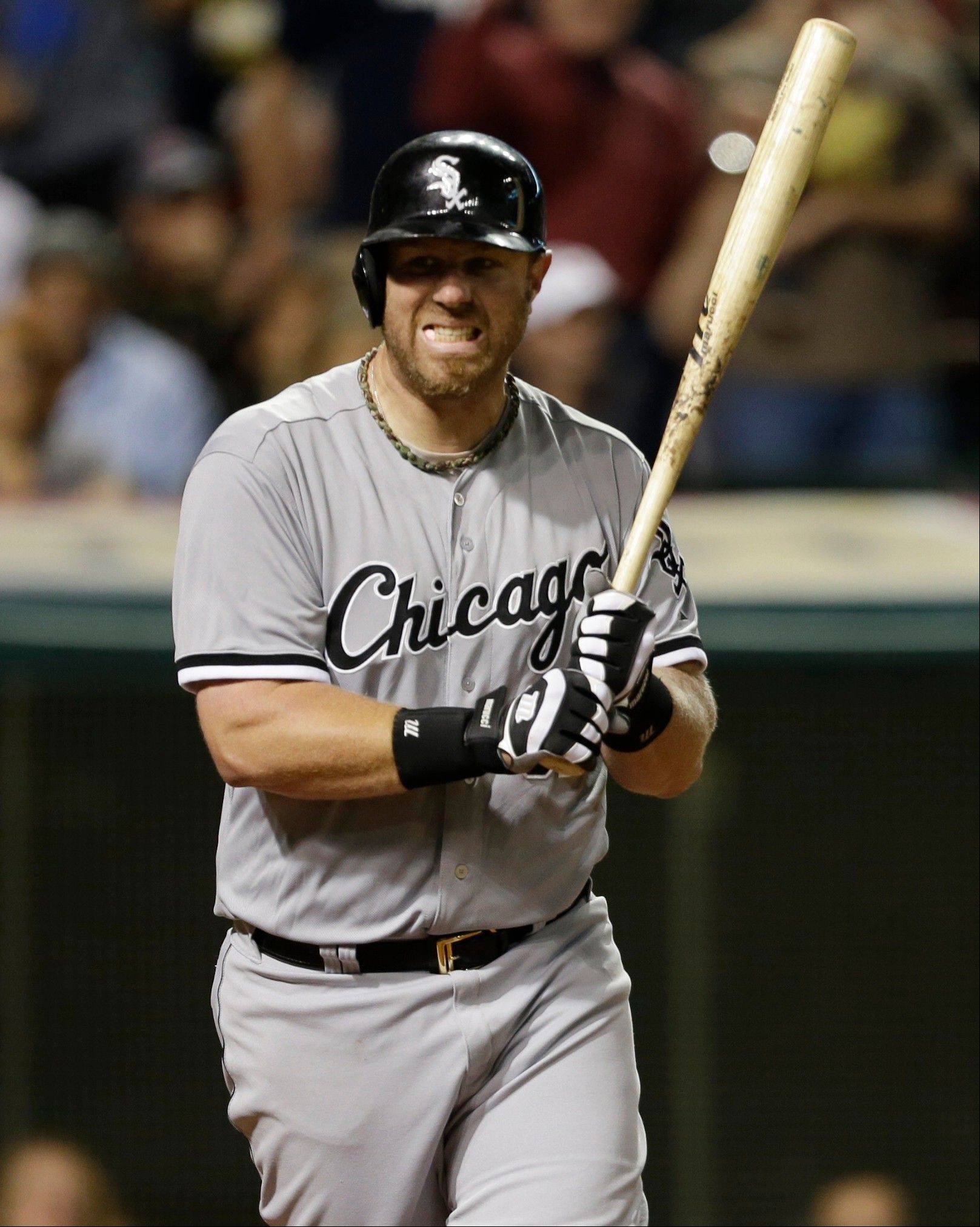 White Sox slugger Adam Dunn reacts after striking out against Cleveland Indians relief pitcher Rich Hill in Monday's eighth inning at Progressive Field.