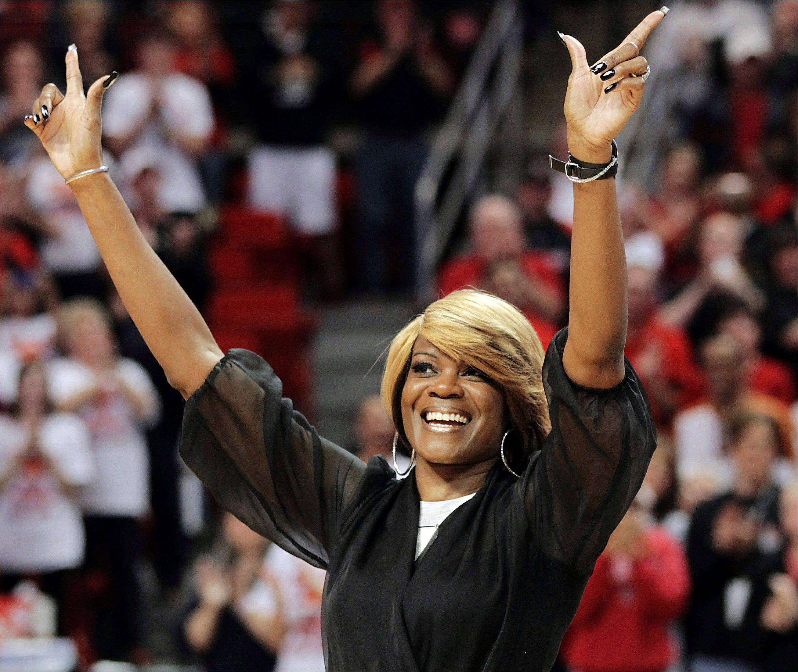 Sheryl Swoopes acknowledges the crowd during a ceremony earlier this year to honor the 1993 Texas Tech national championship team at an NCAA college basketball game between Texas Tech and Texas in Lubbock, Texas. The WNBA great, one of the league's first stars, is now the coach of the Loyola University Ramblers.