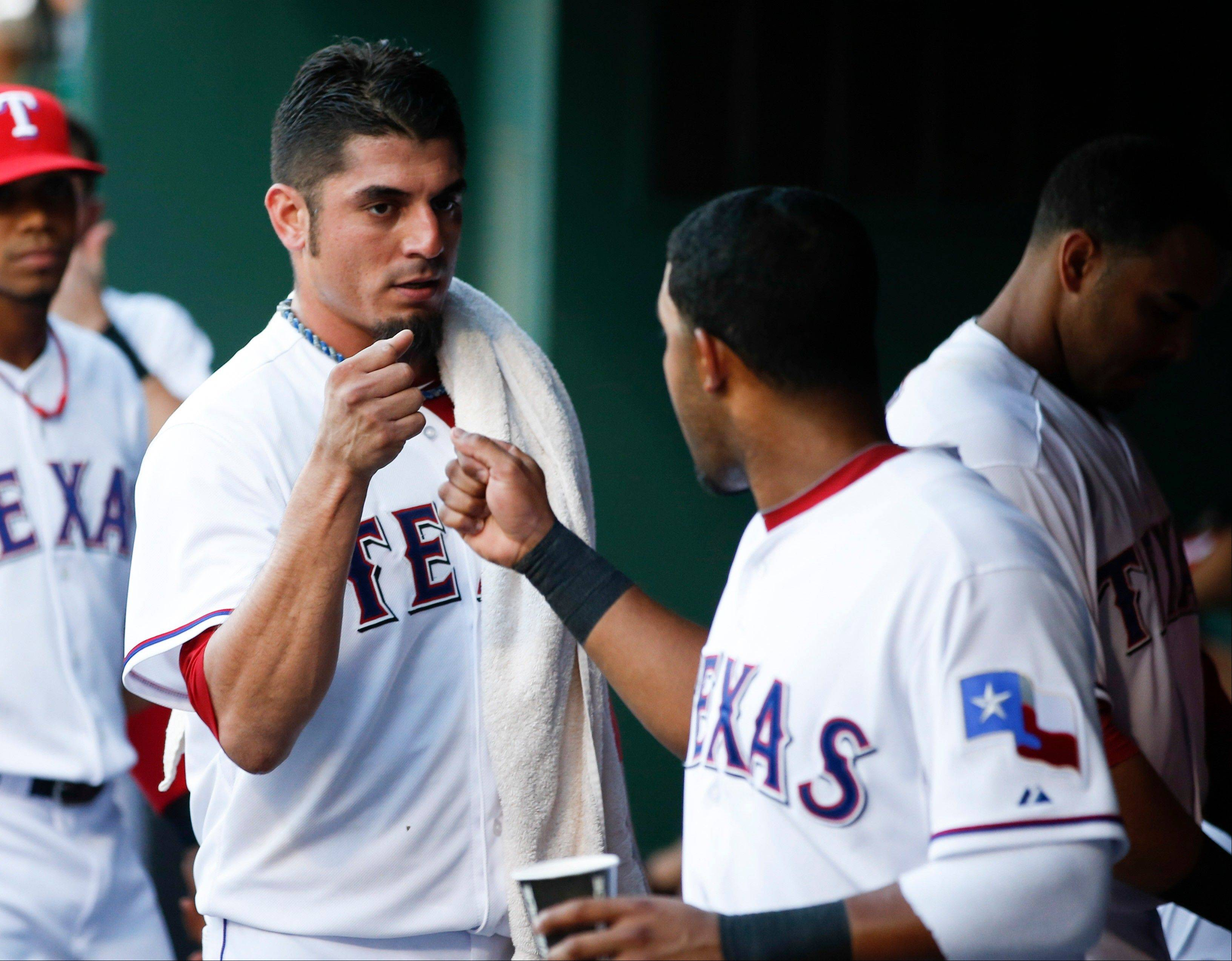 Matt Garza, left, fist-bumps Rangers teammate Elvis Andrus after pitching in the third inning against the Yankees on Wednesday. Garza had an impressive run with the Cubs, but the North Siders did the right thing in acquiring some nice prospects last week in a trade, according to Len Kasper.