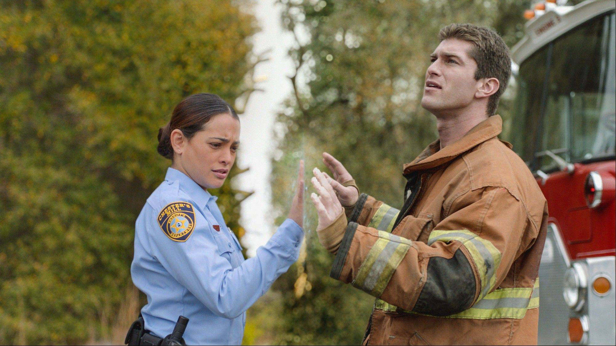 "Natalie Martinez and Josh Carter star in the CBS series ""Under the Dome,"" which has been renewed for a second season."