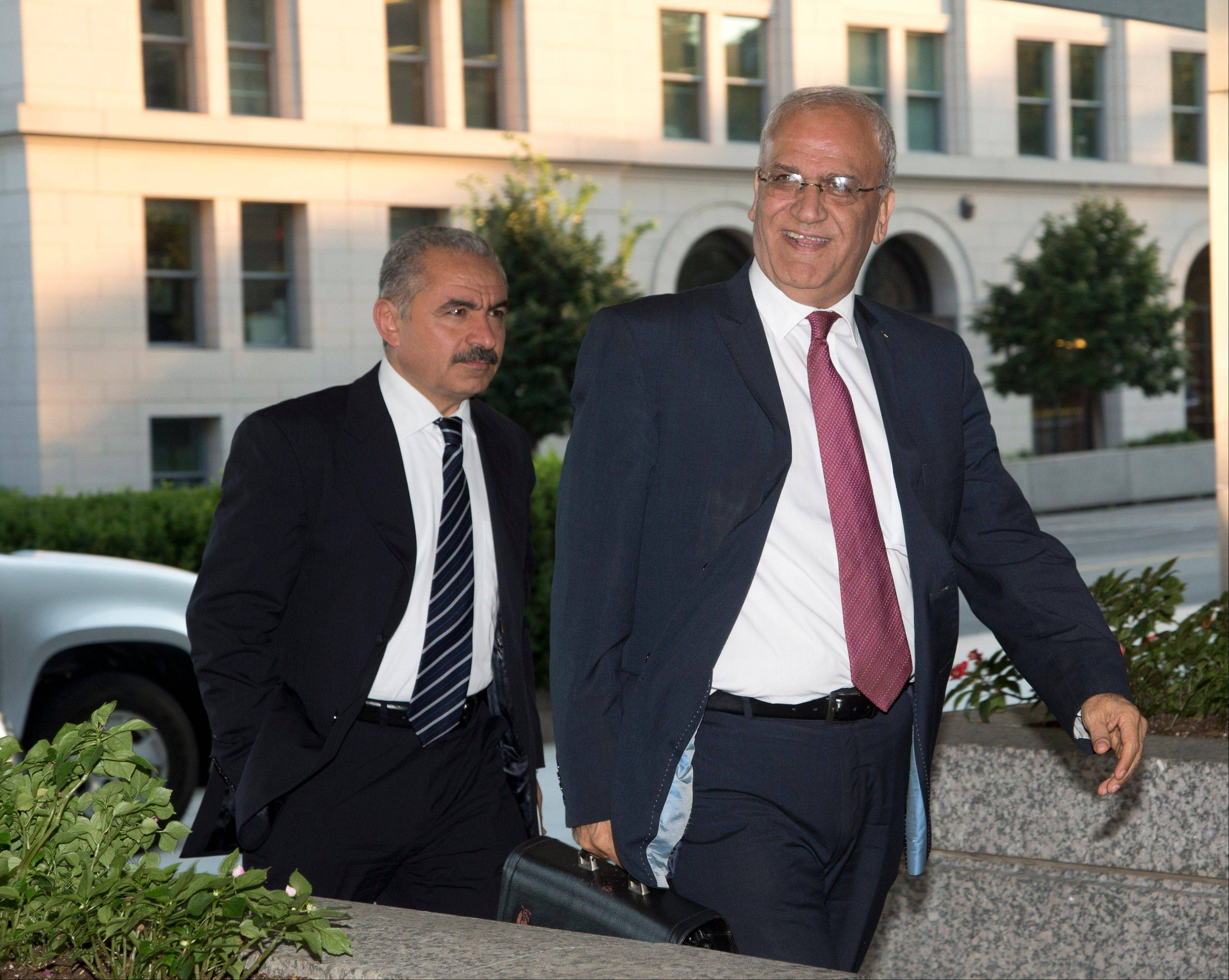 ASSOCIATED PRESSSaeb Erekat, right, Palestinian chief negotiator and Mohammad I. Shtayyeh, left, Minister Palestinian Economic Council for Development and Reconstruction, arrive at the State Department in Washington Monday for the start of Mideast peace talks.
