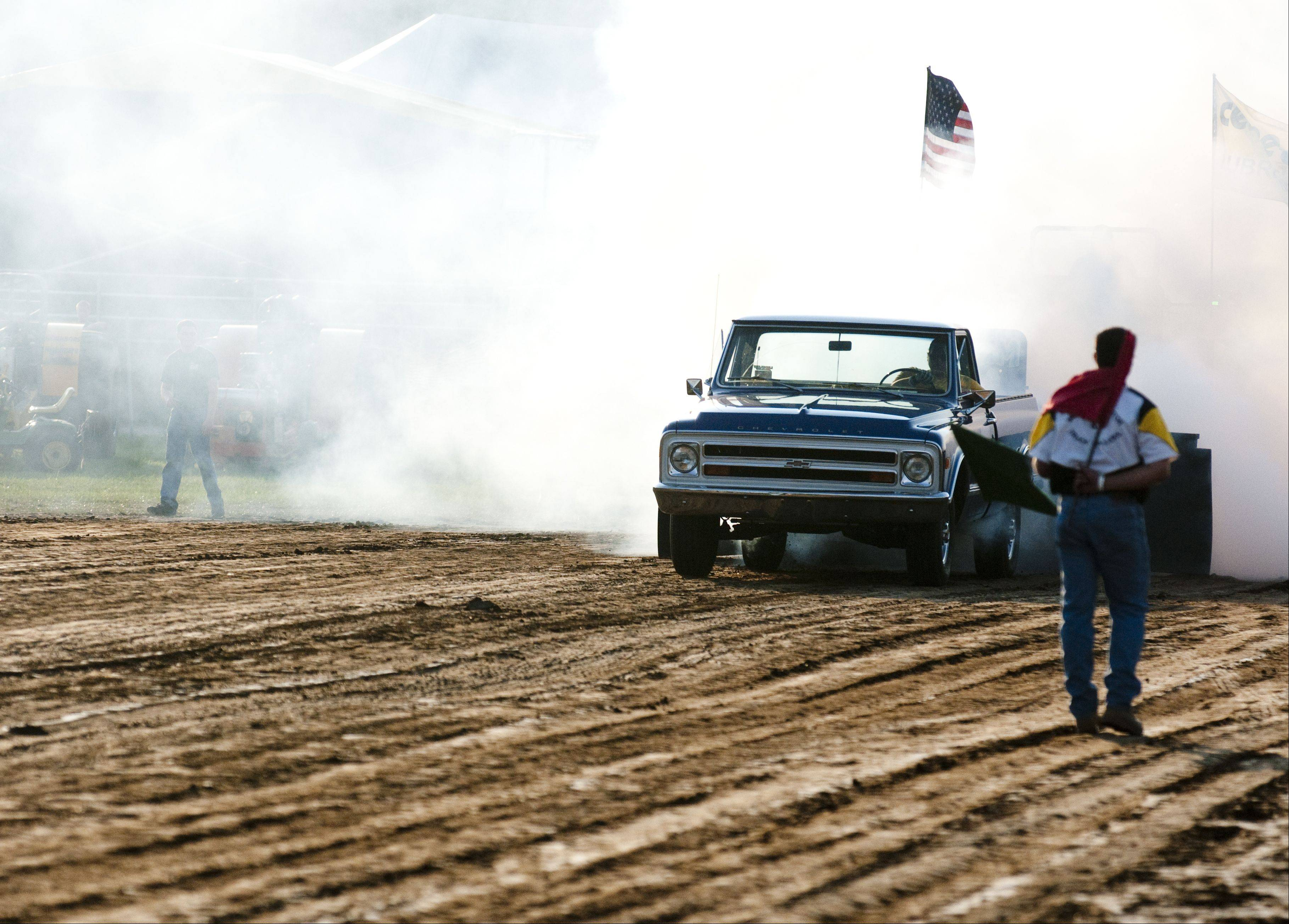 The first competitor kicks up dust to start the Truck and Tractor Pulls competition at last year's McHenry County Fair.