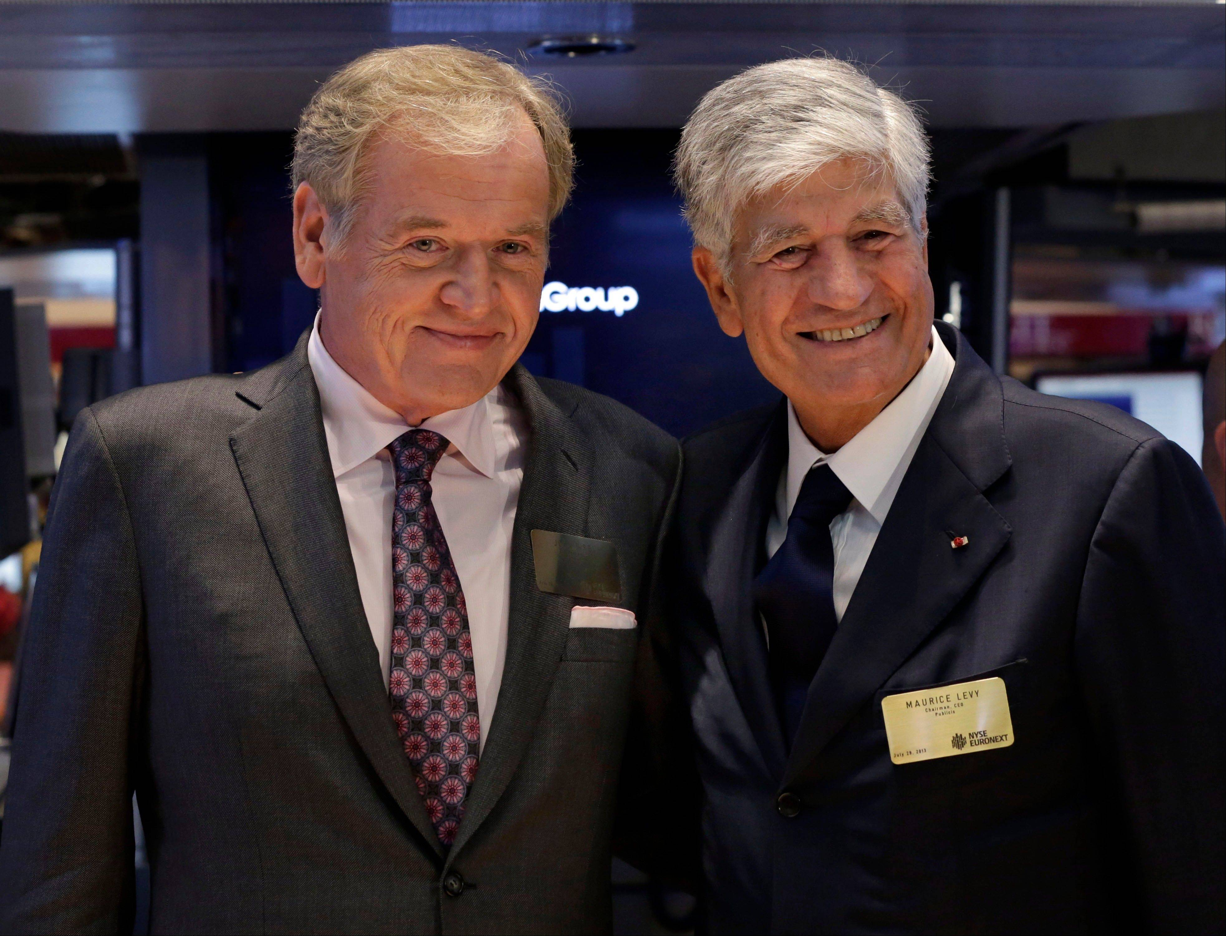 Omnicom Group President and CEO John Wren, left, and Publicis Groupe Chairman and CEO Maurice Levy met on the floor of the New York Stock Exchange Monday. Omnicom Group Inc. and Publicis Groupe SA are merging to create the world's largest advertising firm, one worth more than $35 billion.