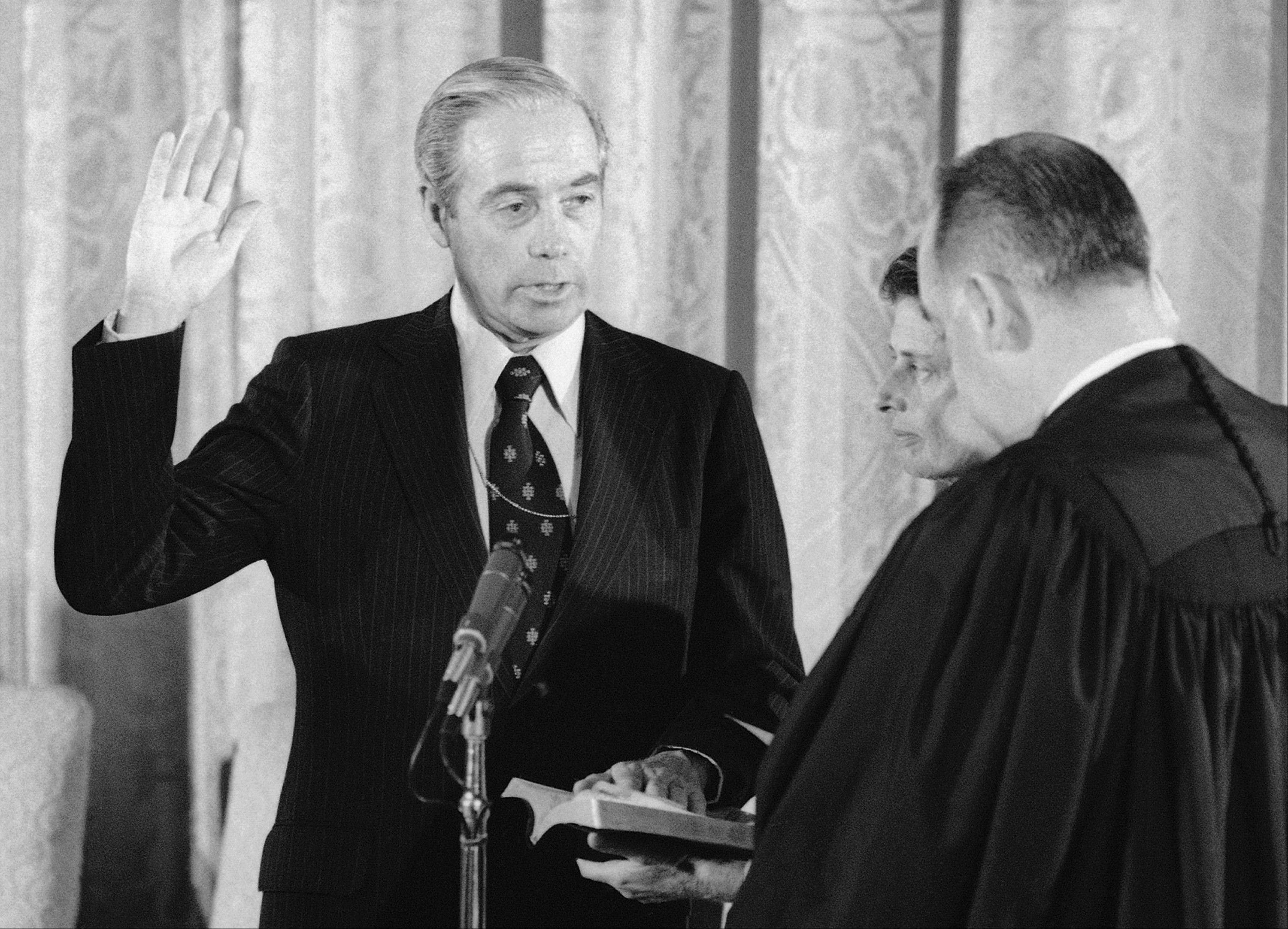 In this 1976 file photo, William Scranton Jr., left, is sworn-in as U.S. ambassador to the United Nations by Associate Supreme Court Justice Potter Stewart at the White House in Washington. Scranton, former Pennsylvania governor, presidential candidate and ambassador to the United Nations, died Sunday. He was 96.