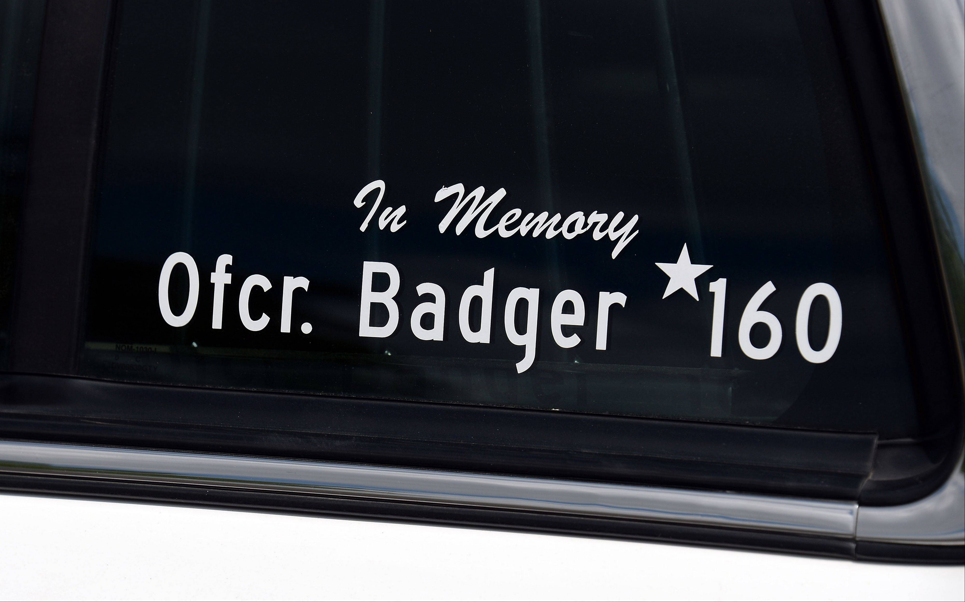 A sticker honoring officer Shamekia Goodwin-Badger is on the police car she regularly used.
