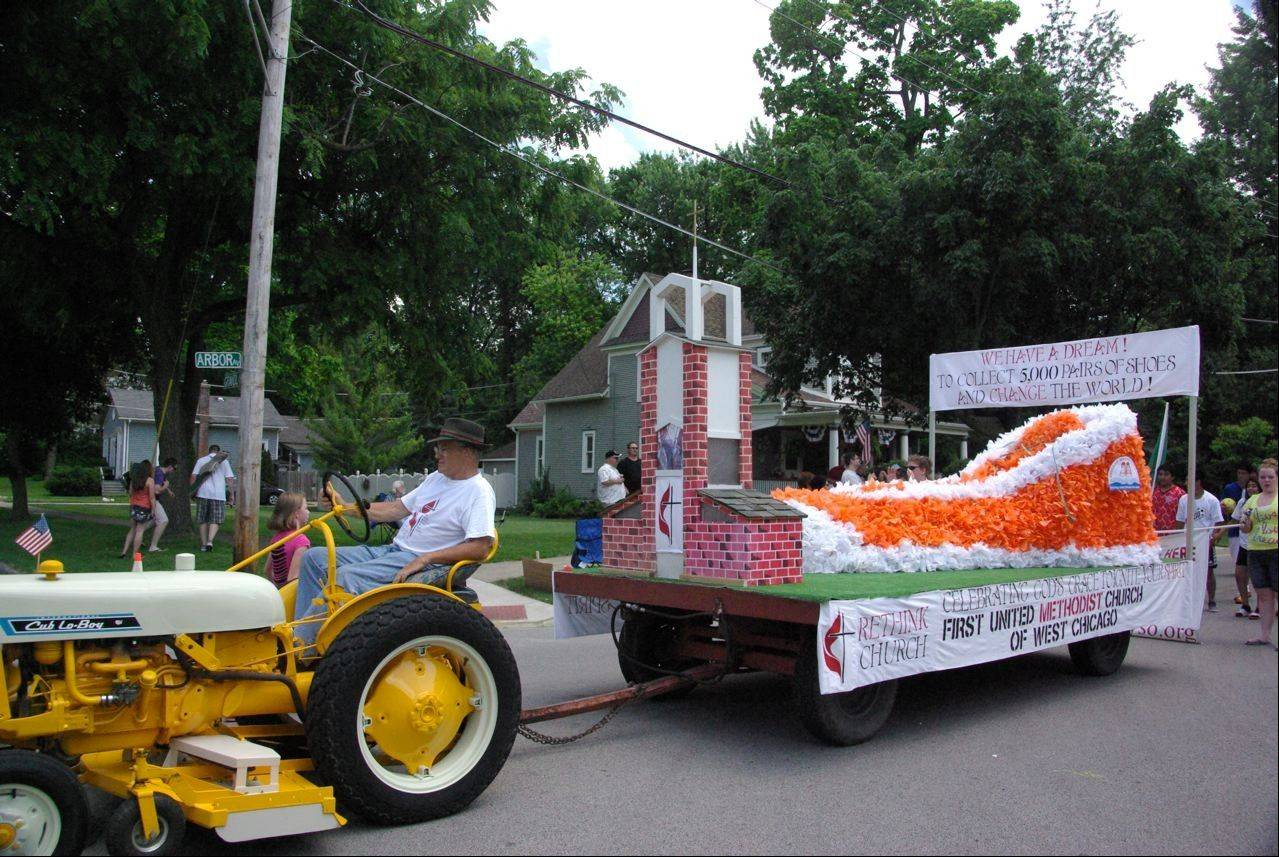 The First United Methodist Church of West Chicago designed its float in the West Chicago Railroad Days parade as an orange high-top shoe in support of its goal of collecting and donating 5,000 shoes to Shoeman Water Projects.