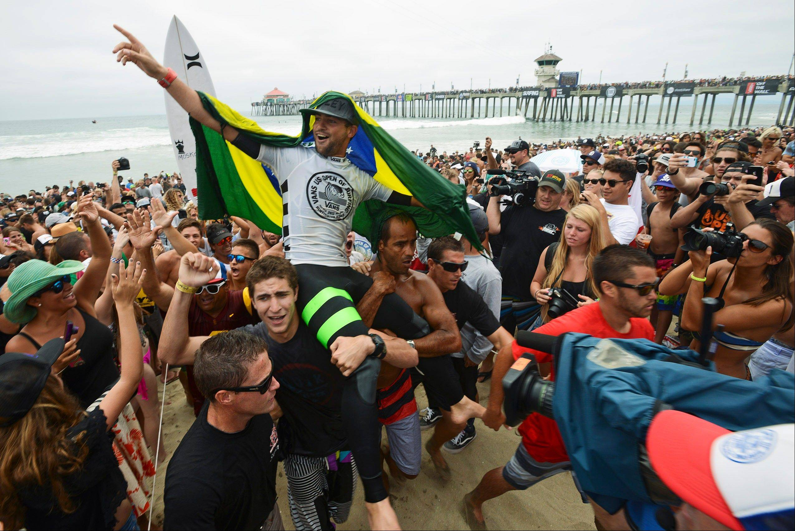 Associated PressAlejo Muniz, of Brazil, was crowned the men's champion of the 2013 Vans US Open of Surfing competition after defeating local surfer Kolohe Andino in the men's final on Sunday, July 28, 2013, in Huntington Beach, Calif. Police say eight people have been arrested after a rowdy crowd surged through downtown after the event, fighting and damaging property.