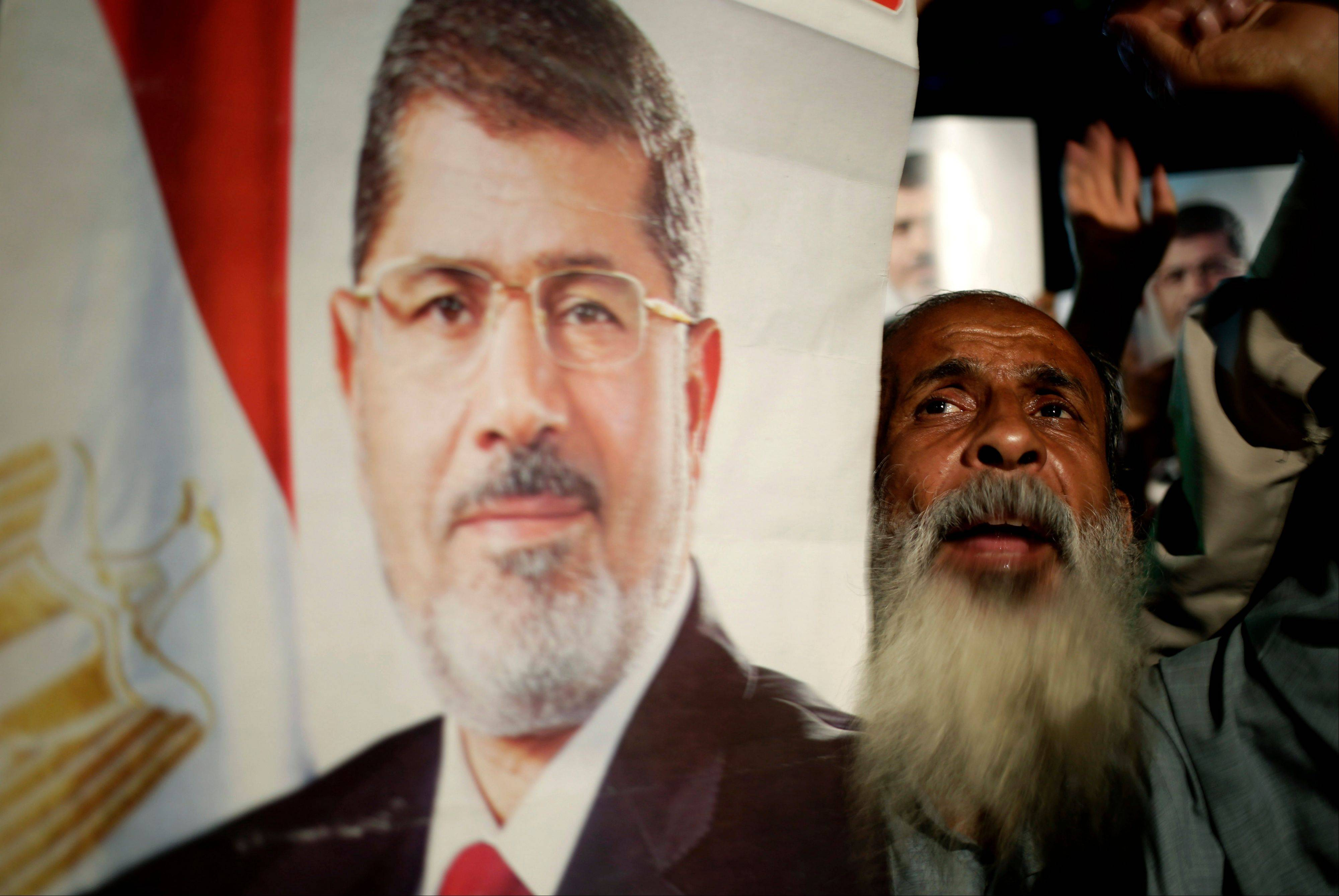 Supporters of Egypt's ousted President Mohammed Morsi chant slogans against Egyptian Defense Minister Gen. Abdel-Fattah el-Sissi at Nasr City, where protesters have installed a camp and hold daily rallies, in Cairo, Egypt, Sunday.