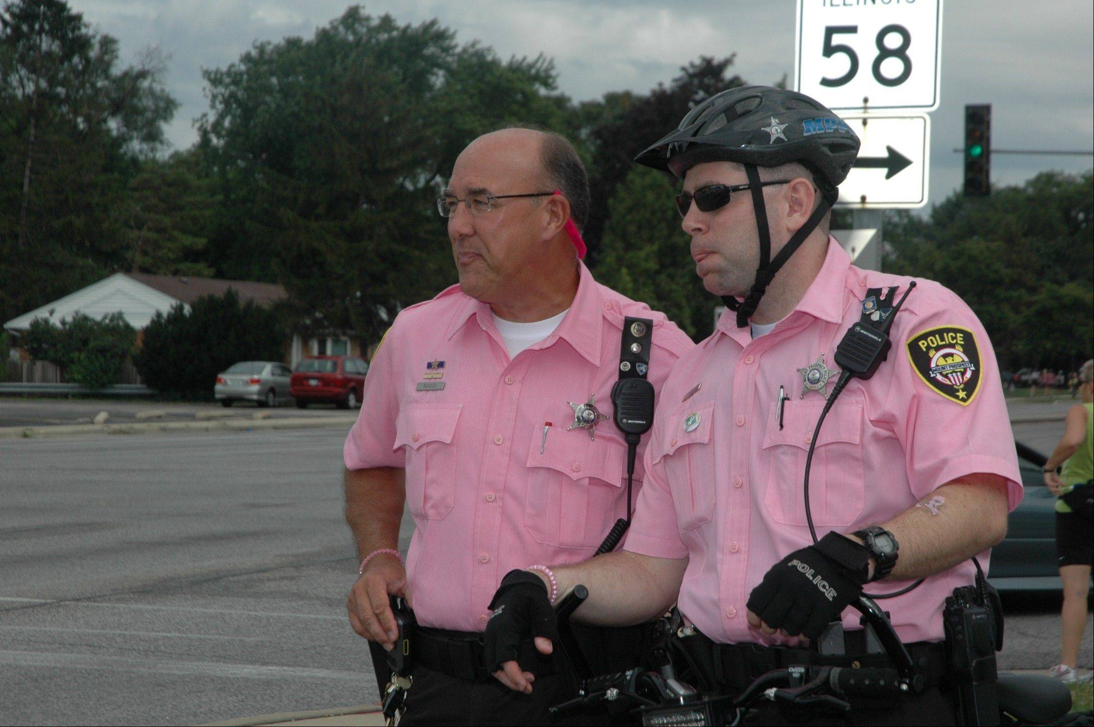 Mount Prospect police officers Bill Roscop, left, and Frank Raus watch over the 2008 Susan G. Komen 3-Day Walk as it comes through Mount Prospect.