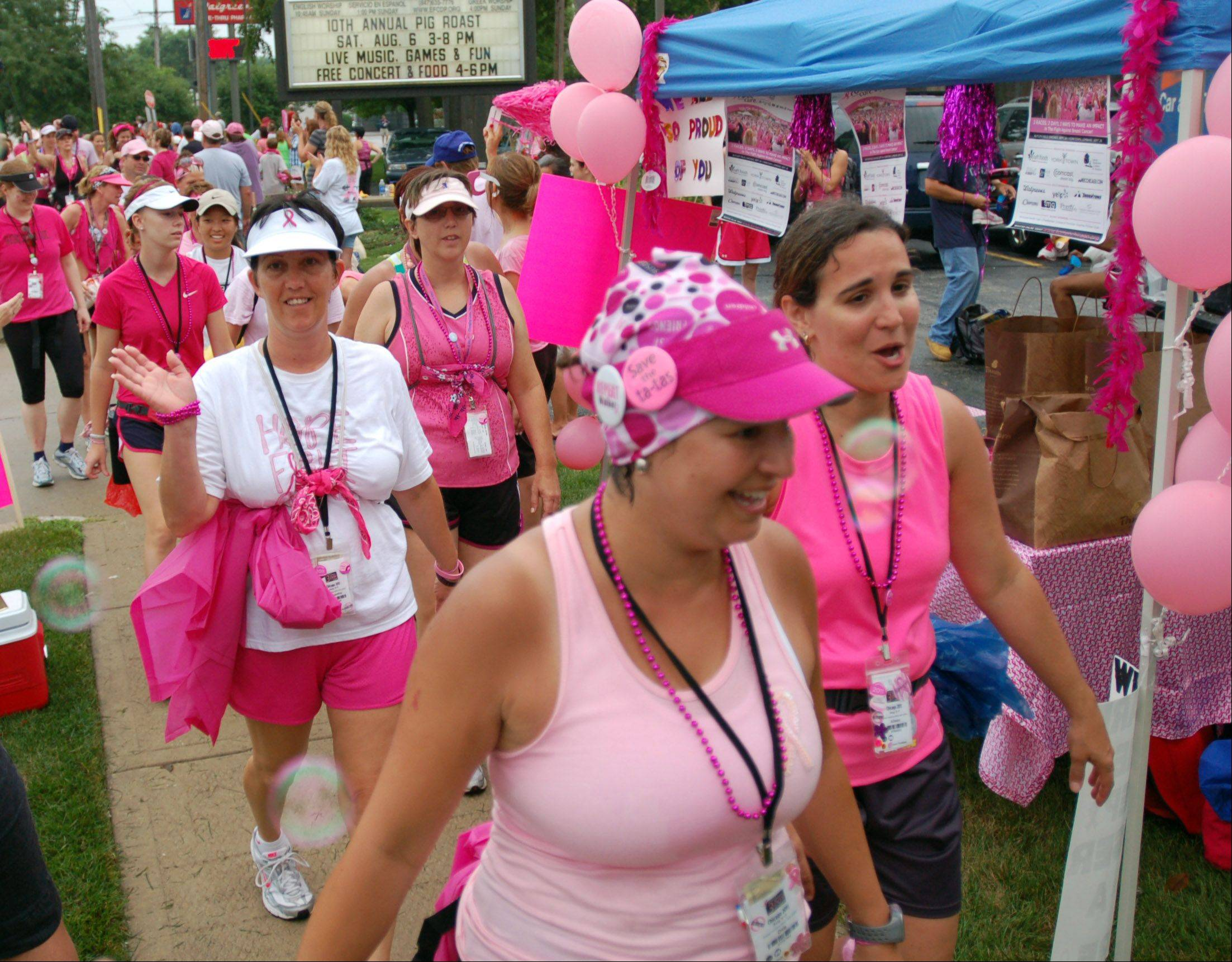 Walkers are in high spirits as they trek through Mount Prospect during a previous Susan G. Komen 3-Day Walk.