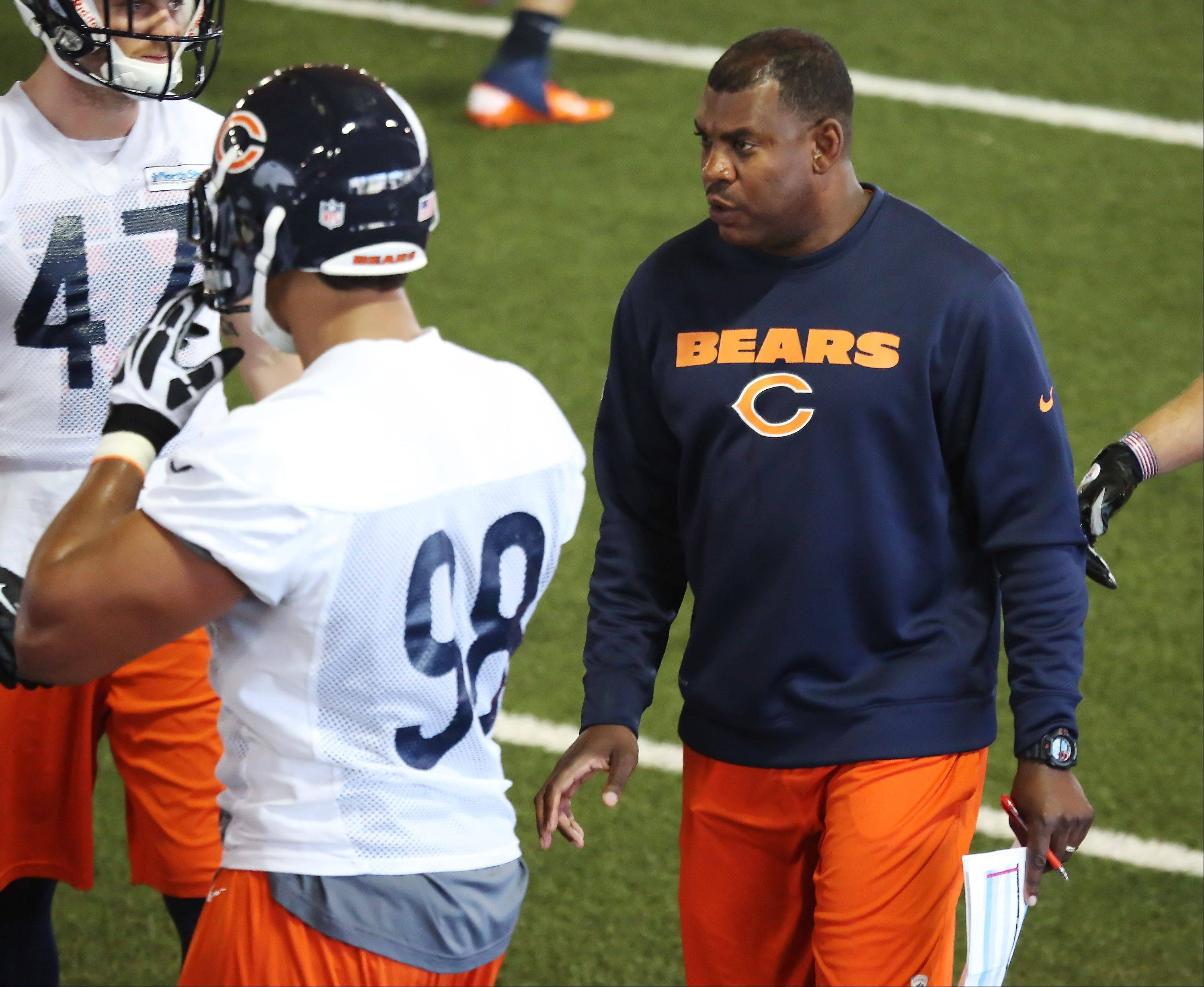 Bears defensive coordinator Mel Tucker, right, talks to players during minicamp at Halas Hall in Lake Forest.