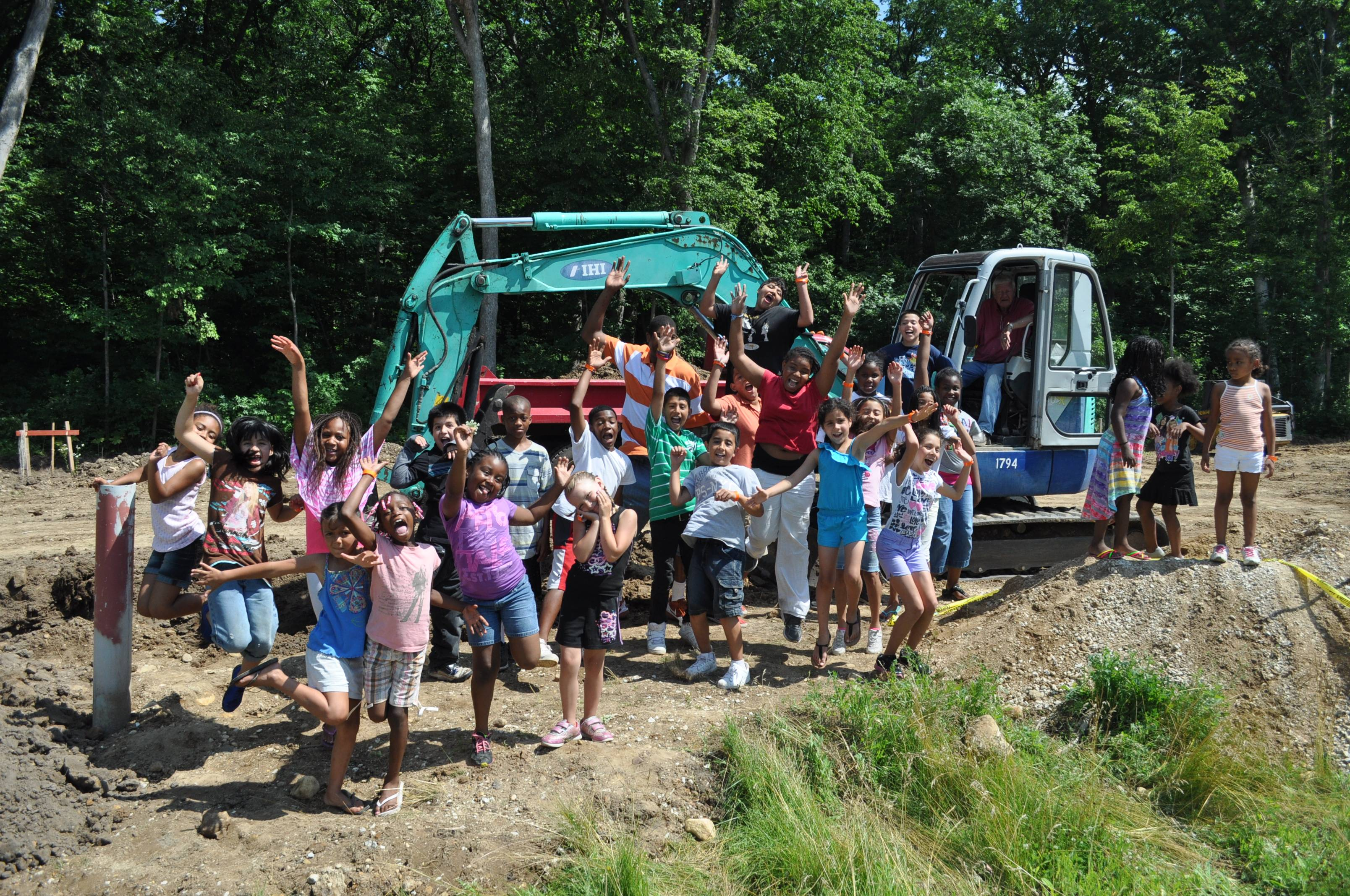Campers celebrate the groundbreaking of Fox Valley Christian Action's 6th new cabin.