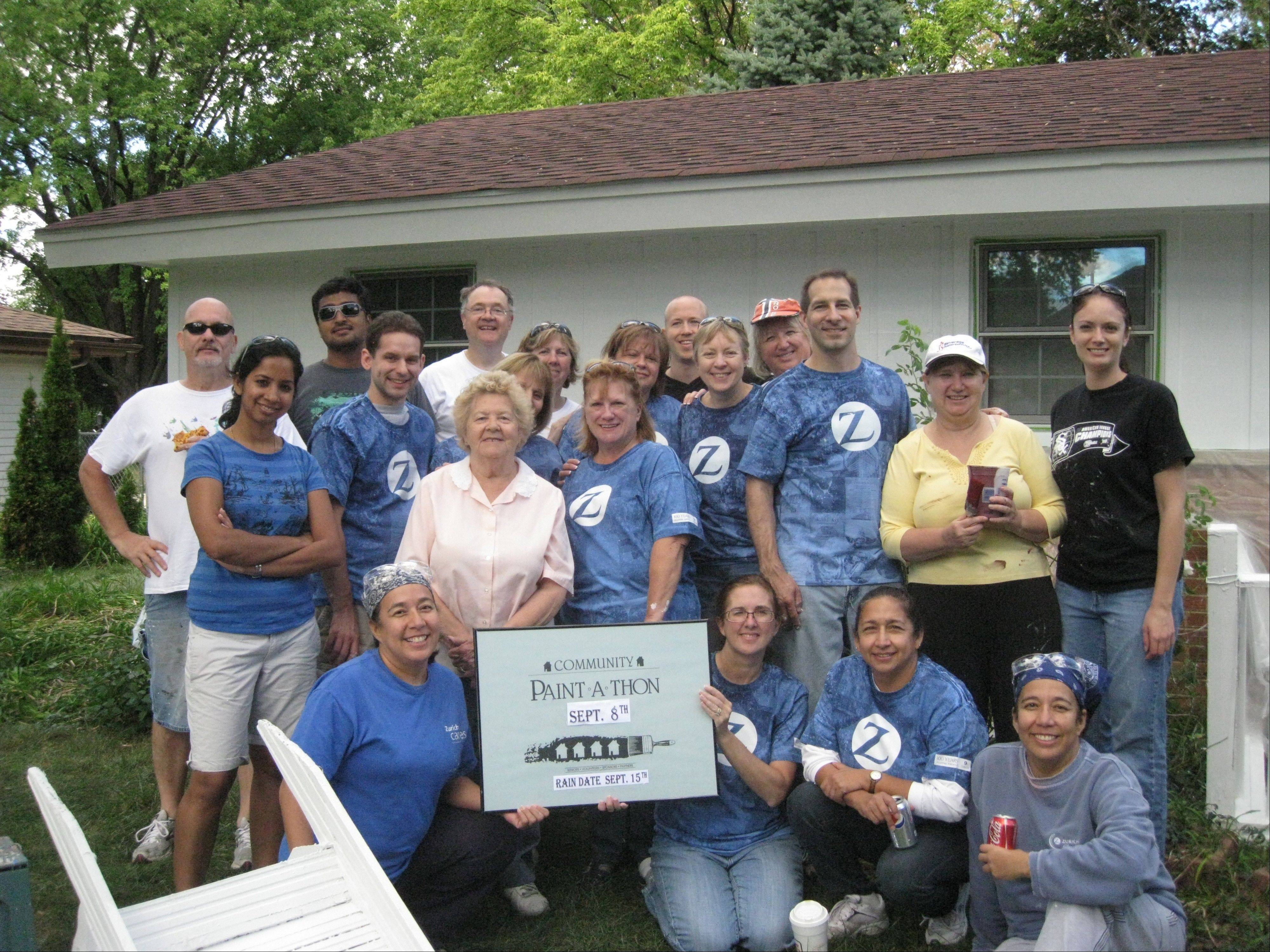 The Zurich Team takes a break at the 2012 Paint-A-Thon event.