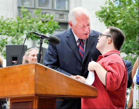 Elliot Walte of Bloomingdale shakes Gov. Pat Quinn's hand after speaking on HB2591, Employment First for Persons with Disabilities.