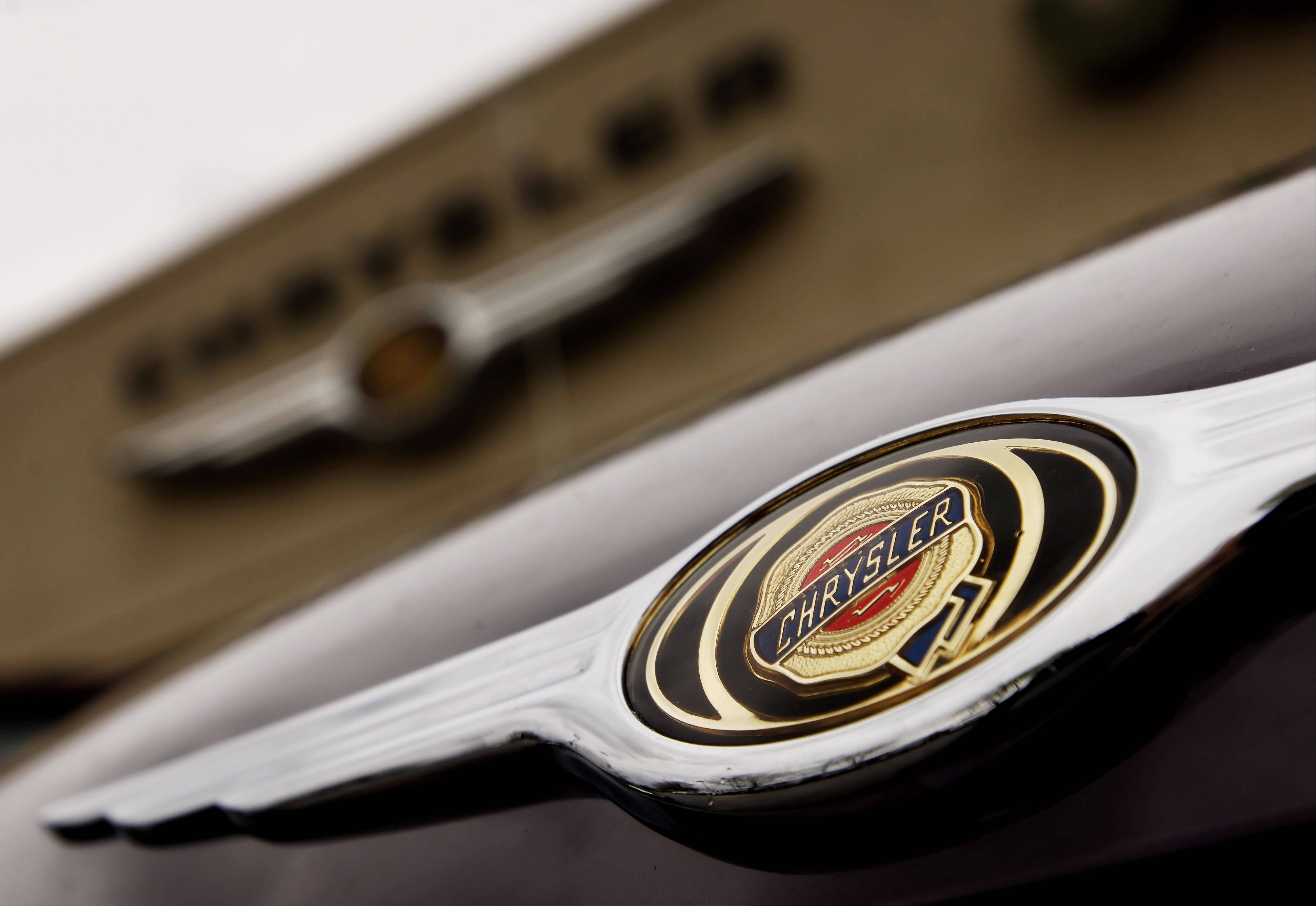 Chrysler Group�s sales picked up in the second quarter thanks to strong U.S. demand for trucks and SUVs, but the company still cut its full-year sales and profit targets after a slower than expected start to the year.