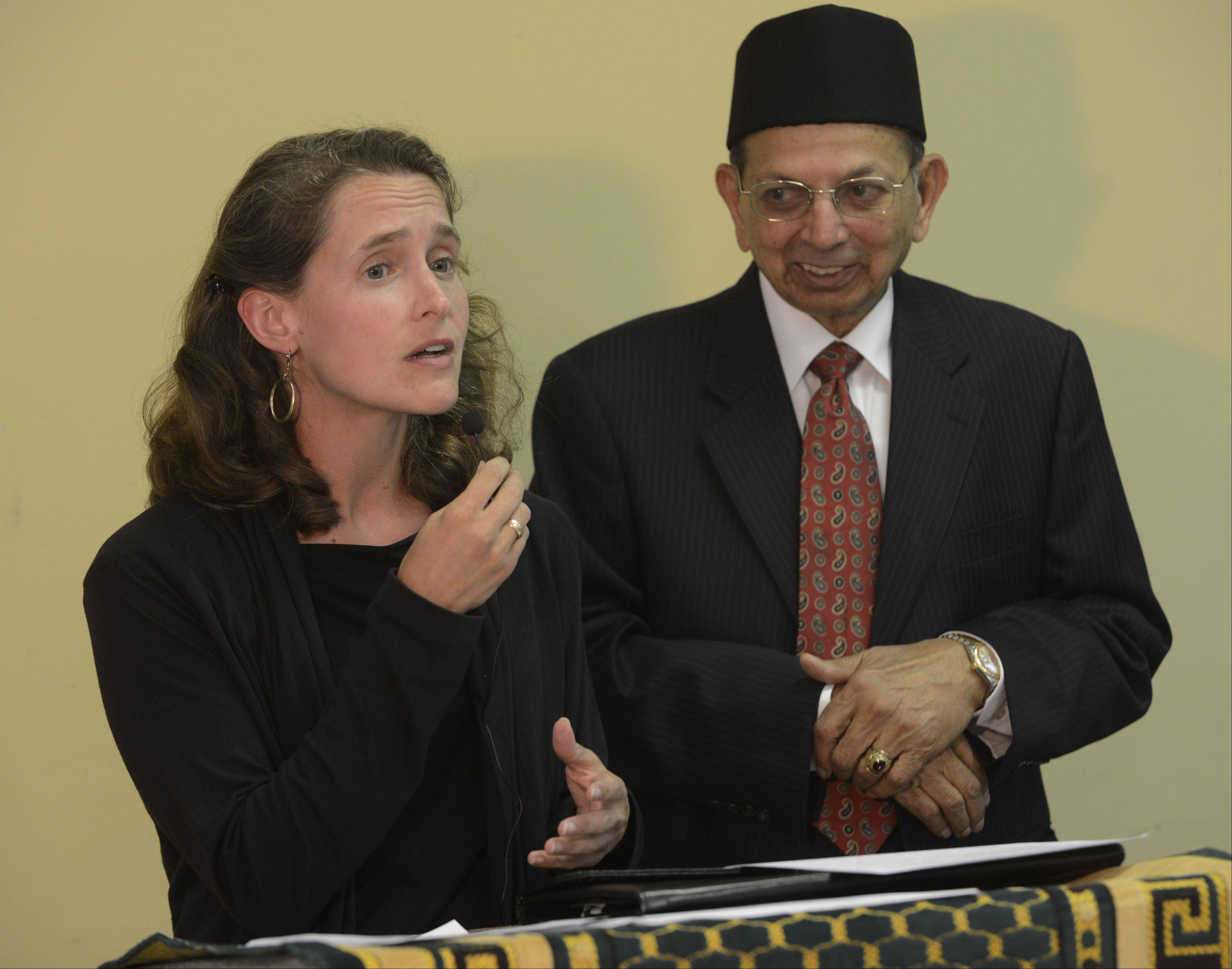 State Rep. Michelle Mussman speaks while standing with Dr. Khalid Sami during the iftar dinner Thursday night at Masjid Al Huda in Schaumburg.