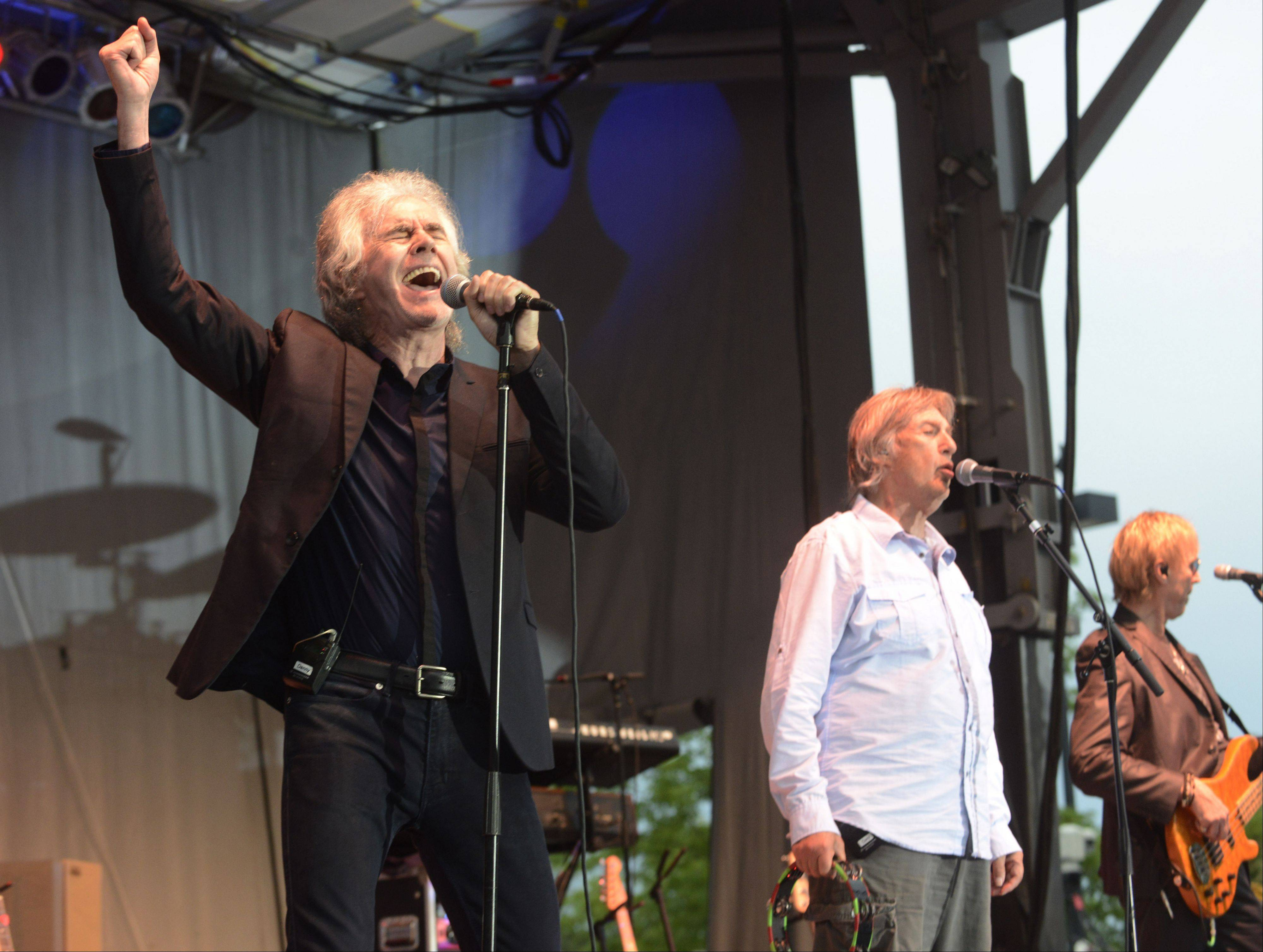 Danny Hutton, left, sings with Three Dog Night on Tuesday as part of the Mid-Summer Classics Concert Series in Elk Grove Village.
