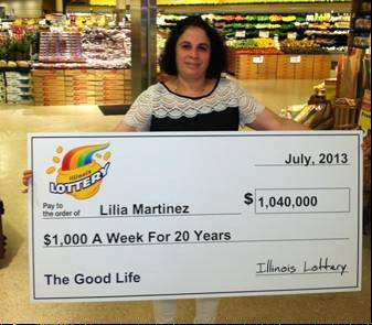 Hoffman Estates resident Lilia Martinez picks up her �check� for $1,040,000 in a ceremony Tuesday at the Jewel on Roselle Road in Hoffman Estates. In fact, she�s being paid in 20 annual installments. She won the money at that same Jewel in an instant lottery game.