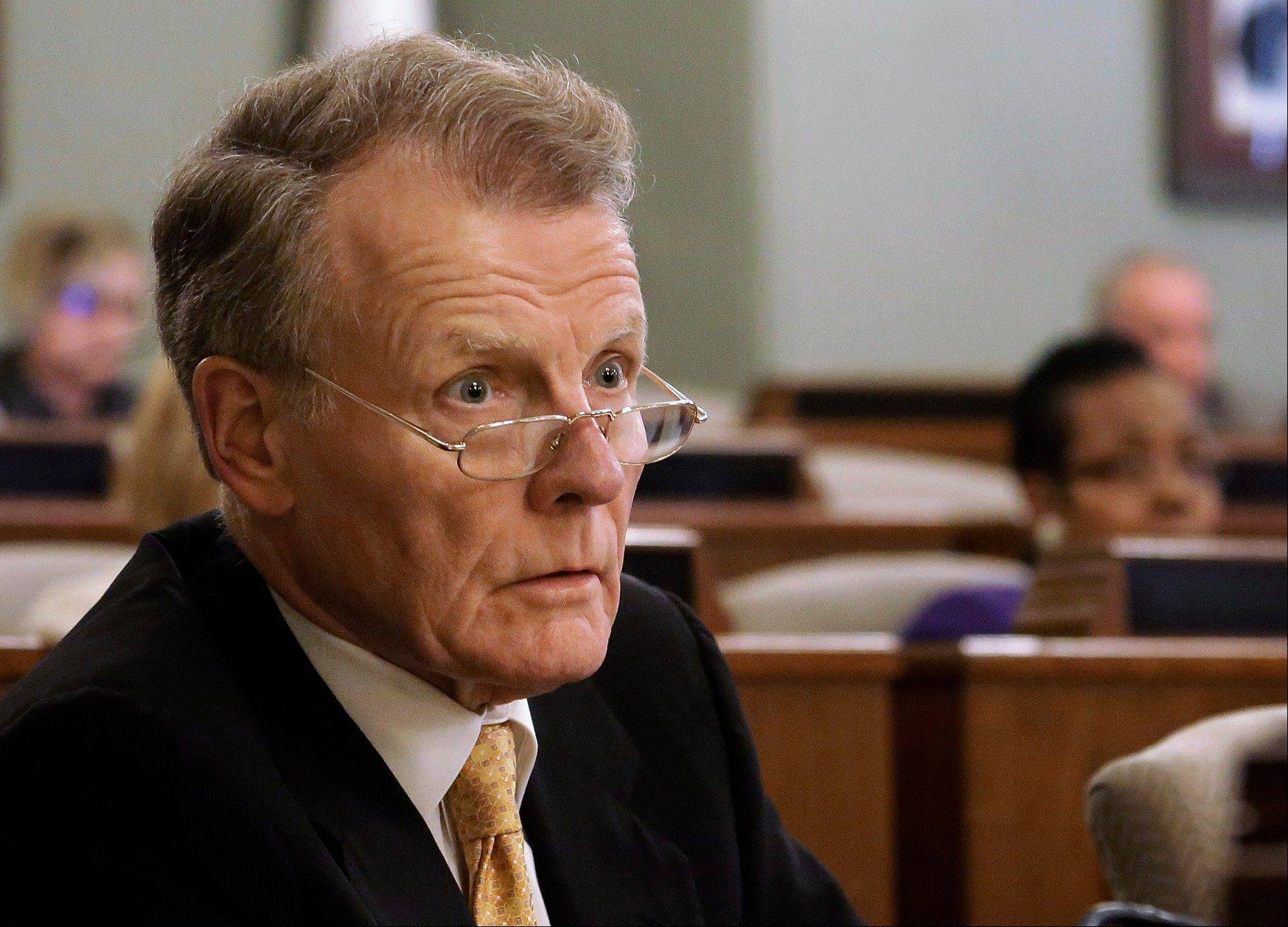 "Illinois House Speaker Michael Madigan speaks to lawmakers during a House committee hearing at the state Capitol in Springfield. Madigan's open invitation on July 19 to have his role in the Metra scandal scrutinized has turned attention once again to the effectiveness of the Illinois Legislature�s 1967 ethics law, deemed ""toothless"" by its own chief ethics investigator."