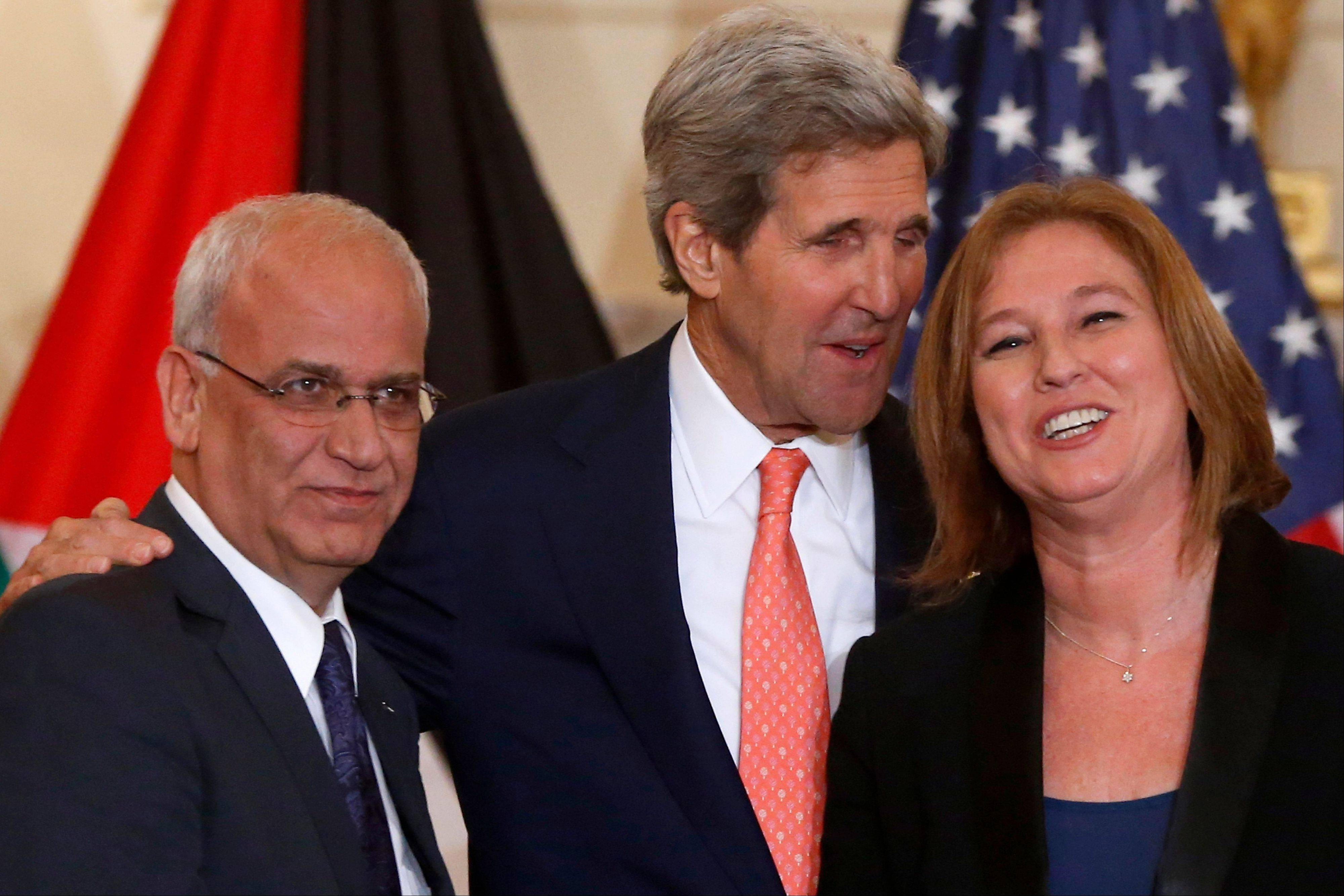 Secretary of State John Kerry stands with Israel's Justice Minister and chief negotiator Tzipi Livni, right, and Palestinian chief negotiator, Saeb Erekat, after they made statements on the resumption of Israeli-Palestinian peace talks Tuesday at the State Department in Washington.