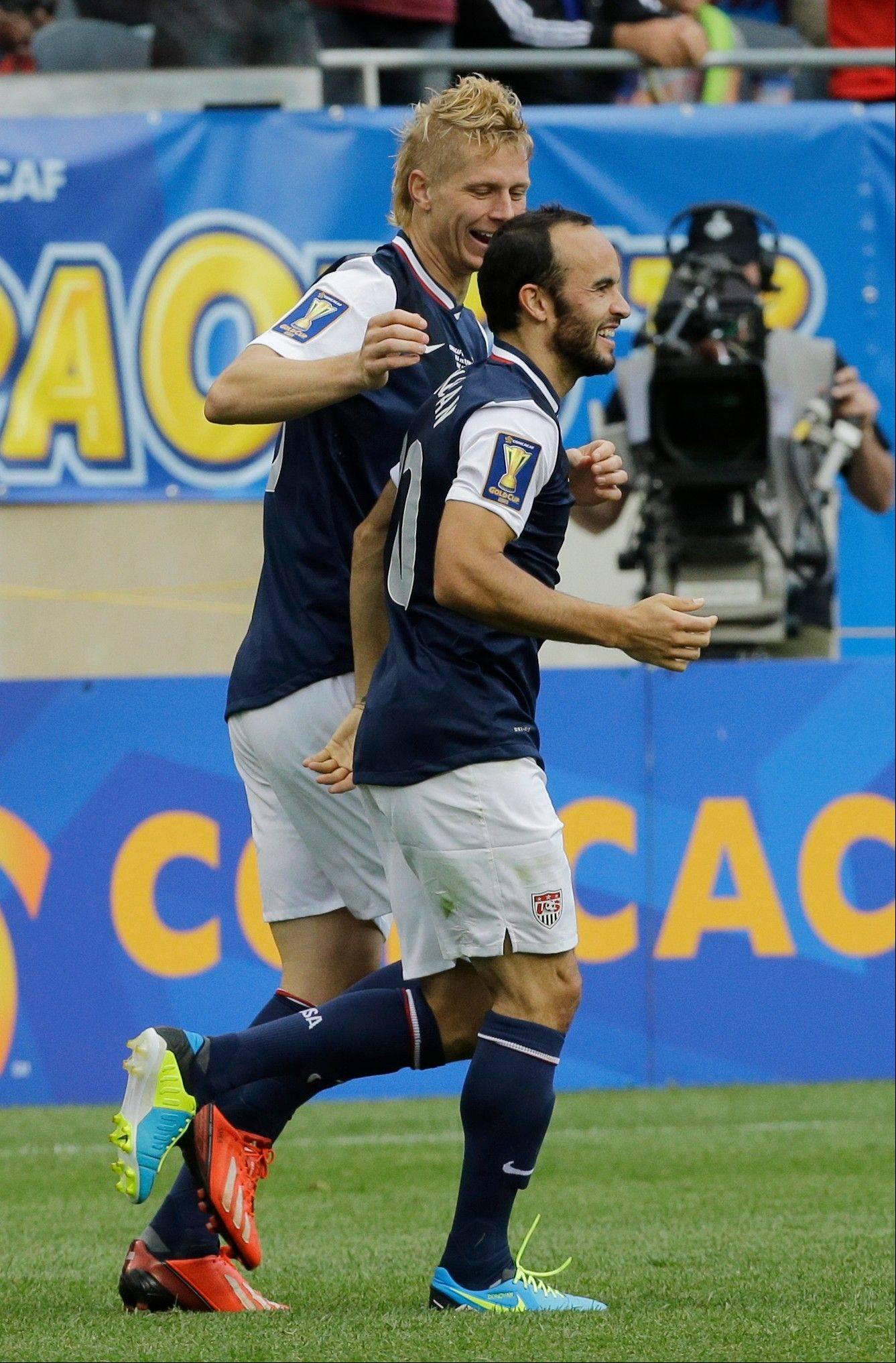 United States� Brek Shea, left, celebrates with teammate Landon Donovan after scoring his goal during the second half of the CONCACAF Gold Cup final soccer match against Panama at Soldier Field last Sunday. United States won 1-0.