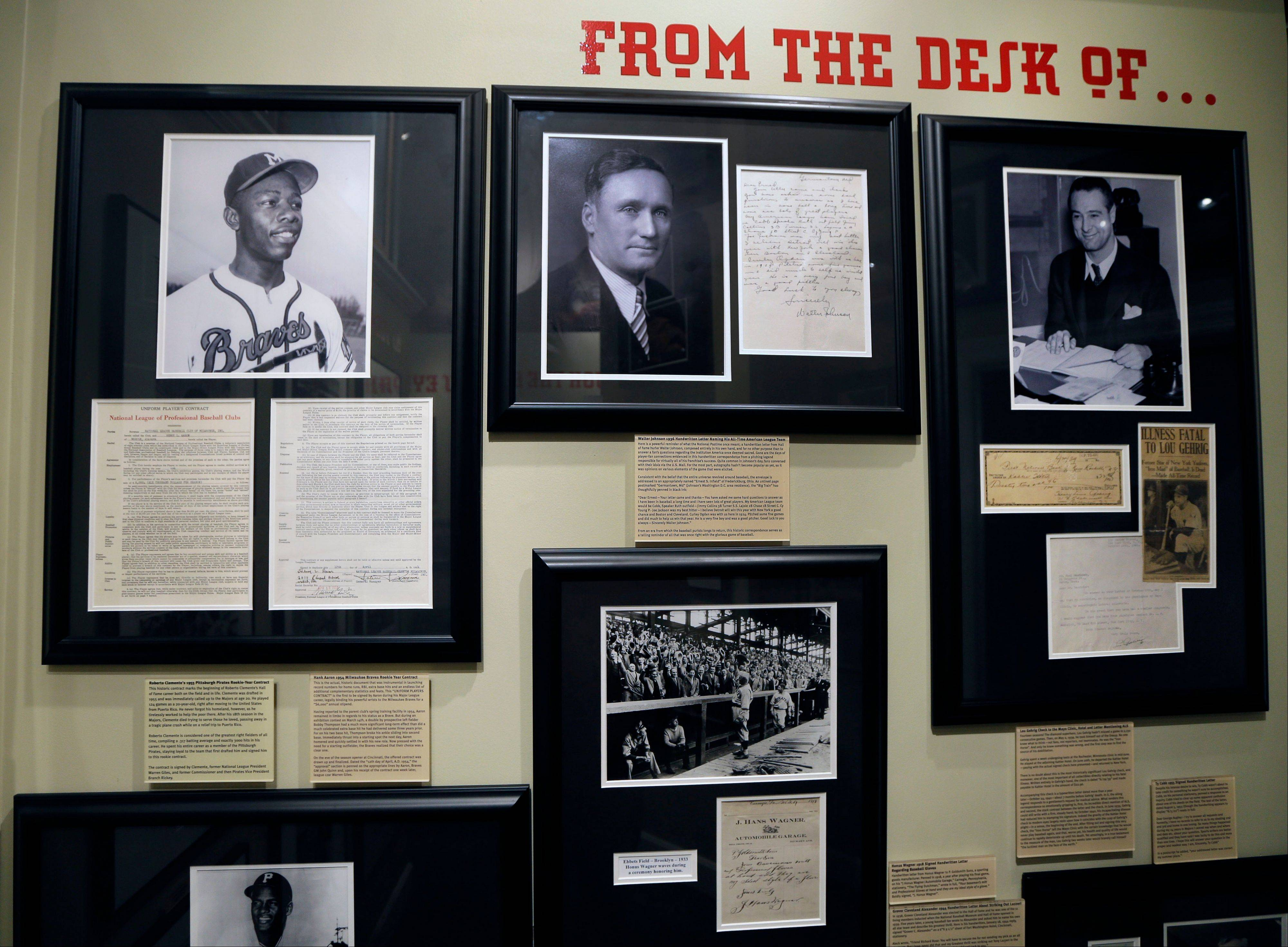 Signed players contracts, personal letters and signed checks from baseball greats such as Henry Aaron, Walter Johnson, Lou Gehrig, and Honus Wagner, are displayed at the Green Diamond Gallery in Cincinnati.
