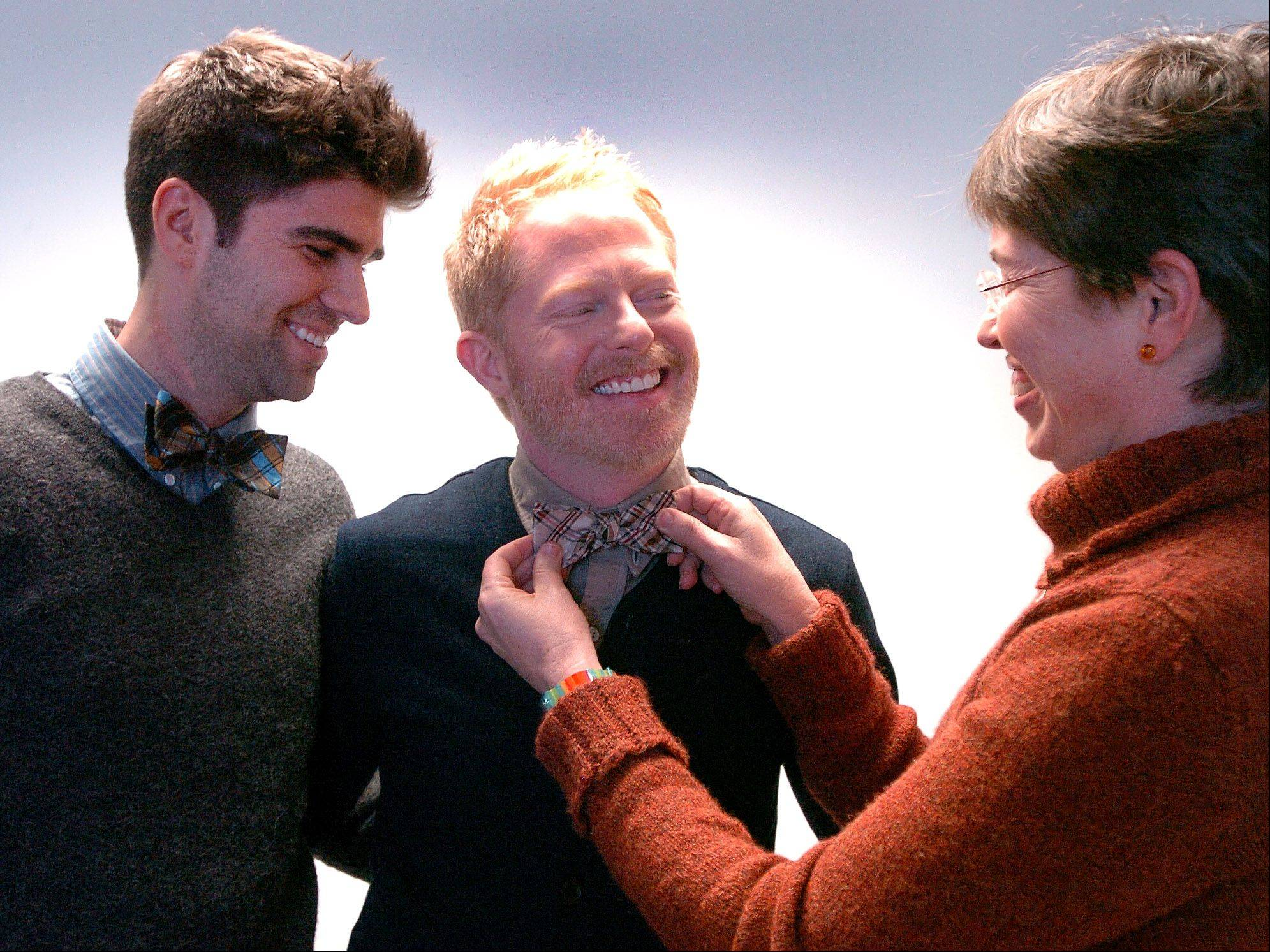 "Earlier this year, Lt. Governor Sheila Simon adjusted the bow tie of actor Jesse Tyler Ferguson, center, along with his partner Justin Mikita, after discussing legislation on gay marriage in Illinois. Ferguson, a star on ABC's ""Modern Family,"" will be honored at the VH1 Do Something Awards for his organization Tie the Knot."