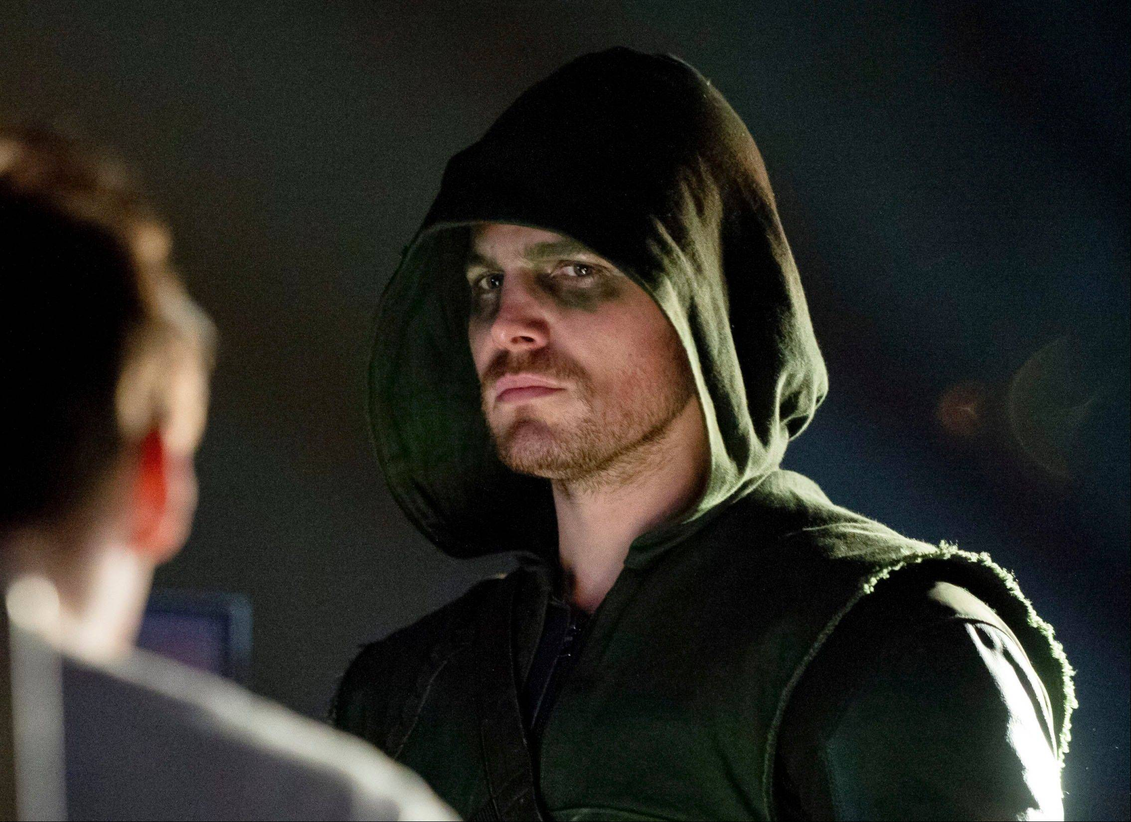 "Stephen Amell as Oliver Queen/Arrow in a scene from ""Arrow."""