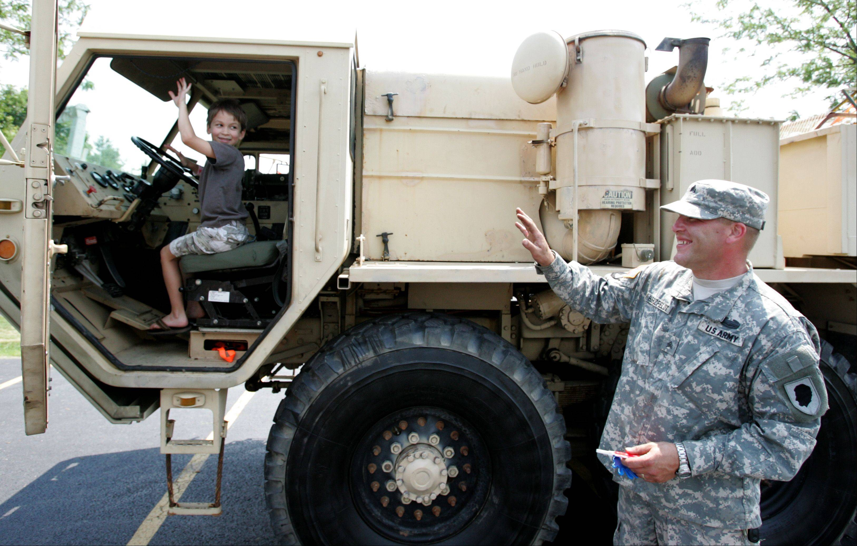 A young driver tests out the horn of a Hemmet Wrecker from the 3625th Maintenance Company of the Illinois National Guard during a previous edition of Big Trucks, sponsored by the Barrington Park District, held at Ron Beese Park.