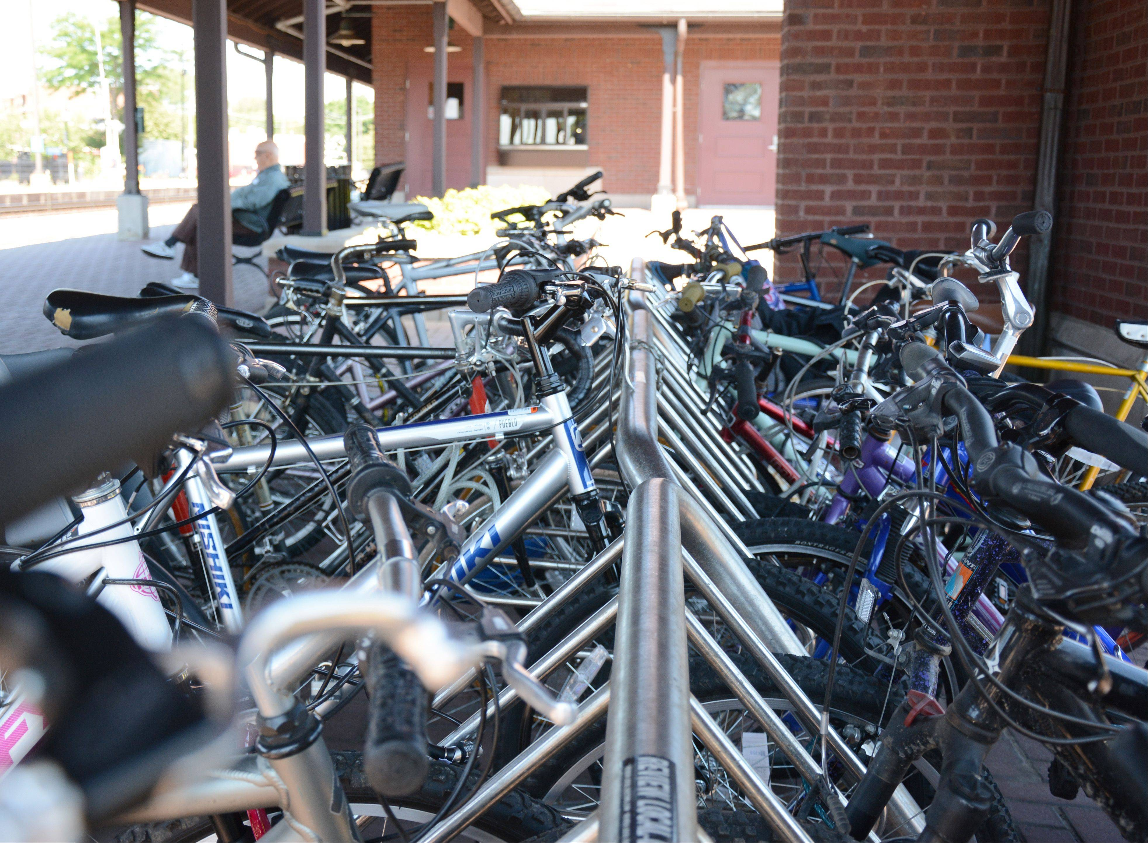 Bikes are locked to a bike rack at the Arlington Heights train station.