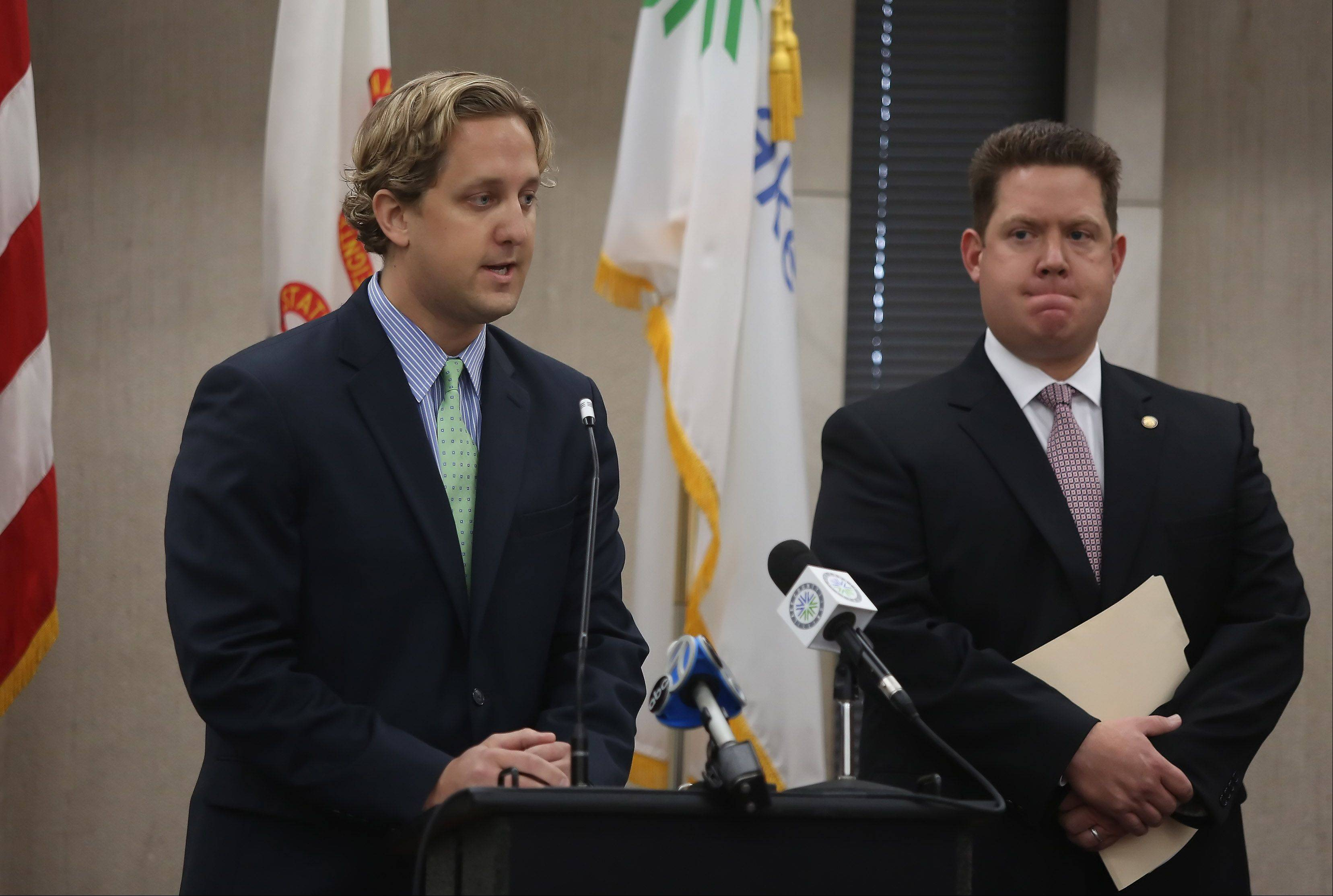 Gilbert R. Boucher II/gboucher@dailyherald.comLake County Board Chairman Aaron Lawlor, left, and Lake County State's Attorney Mike Nerheim announced Tuesday at the Lake County Building in Waukegan that they have filed a lawsuit challenging the constitutionality of House Bill 2418. The bill removes the authority of the county clerk to administer elections and establishes an elections commission without a voter referendum, in Lake County only.