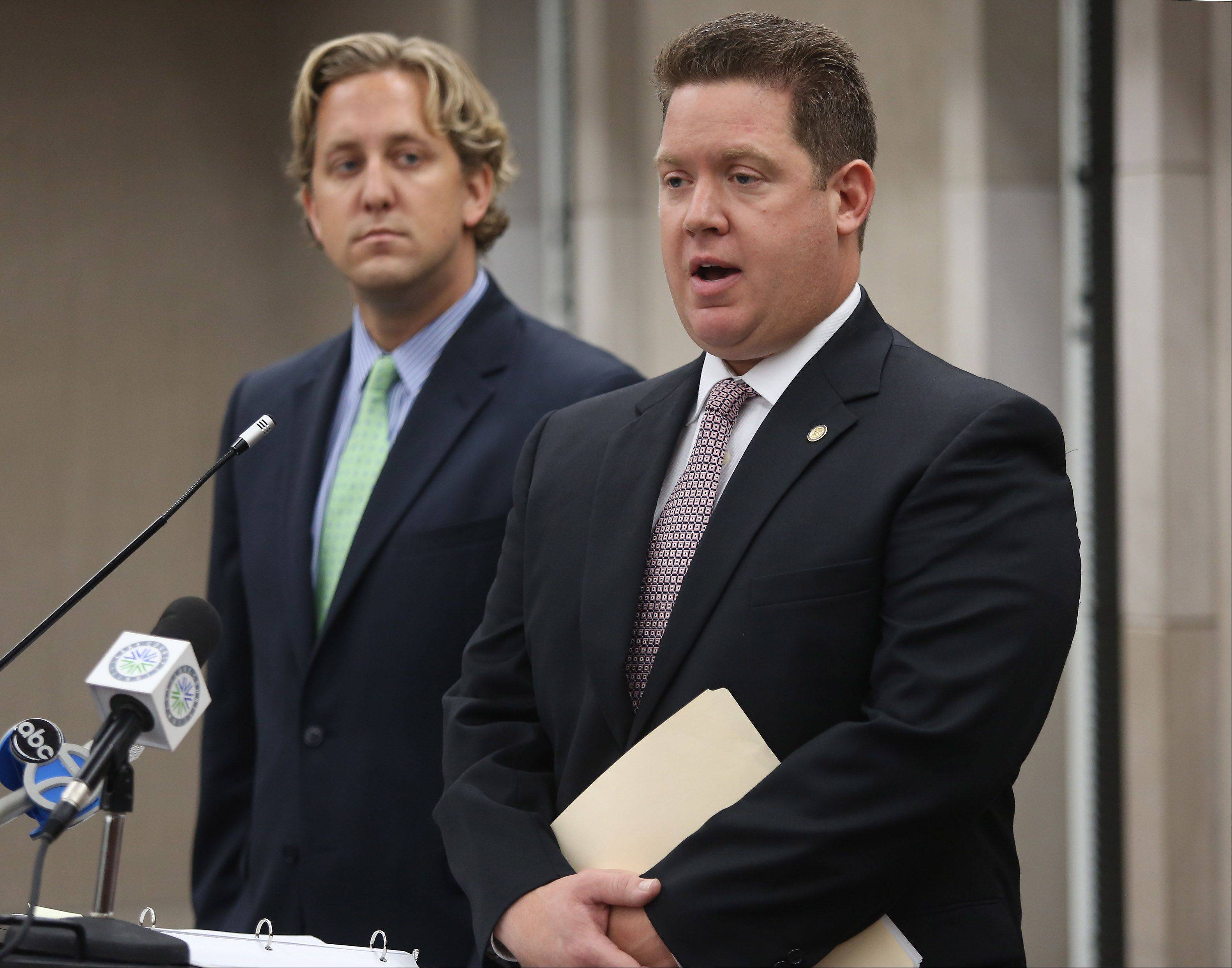Gilbert R. Boucher II/gboucher@dailyherald.comLake County State's Attorney Mike Nerheim, right, and Lake County Board Chairman Aaron Lawlor announced Tuesday at the Lake County Building in Waukegan that they have filed a lawsuit challenging the constitutionality of House Bill 2418. The bill removes the authority of the county clerk to administer elections and establishes an elections commission without a voter referendum, in Lake County only.