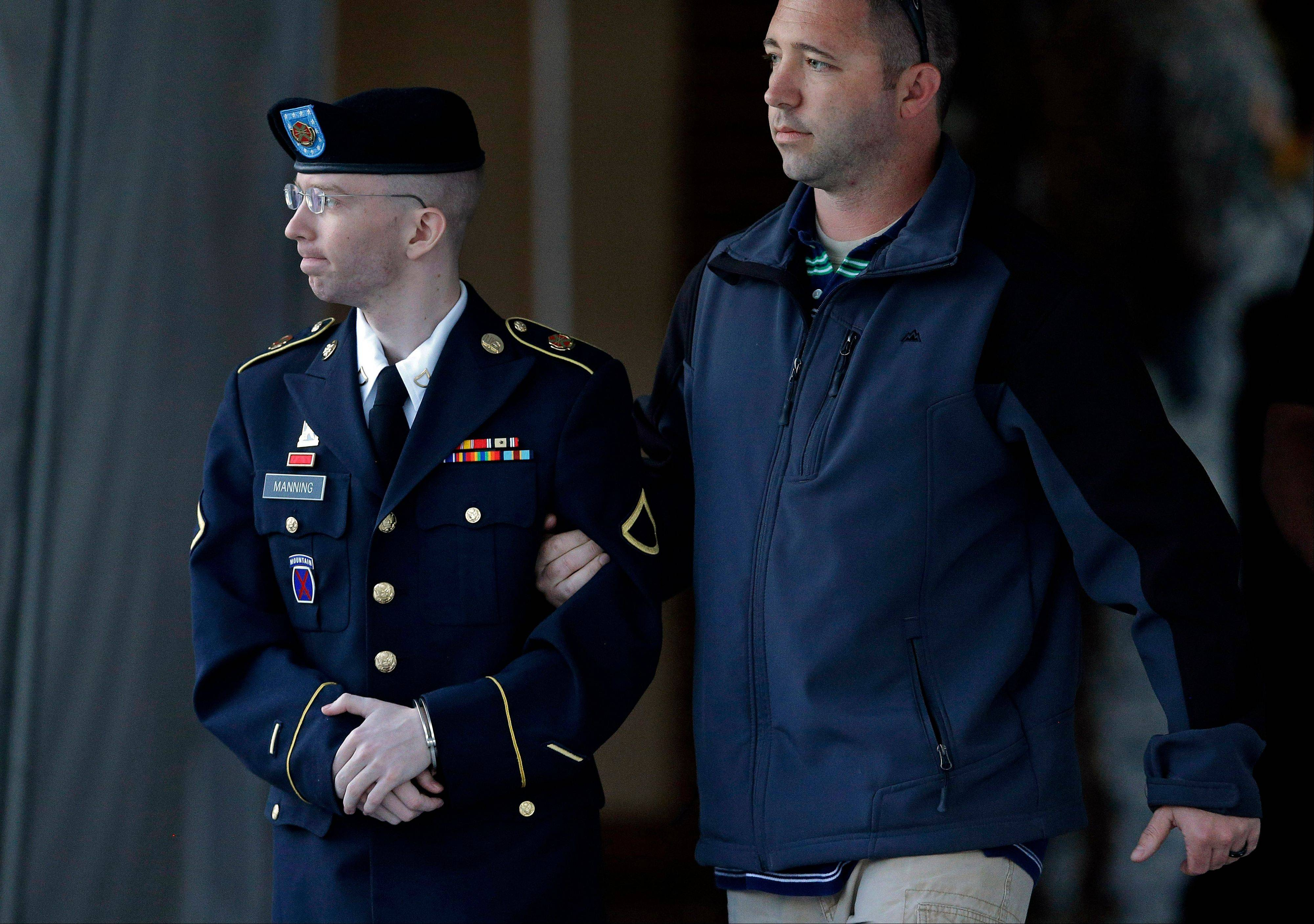 Army Pfc. Bradley Manning, left, is escorted to a security vehicle outside of a courthouse in Fort Meade, Md., Monday, after the third day of deliberations in his court martial. Manning was acquitted of aiding the enemy for giving classified secrets to WikiLeaks.