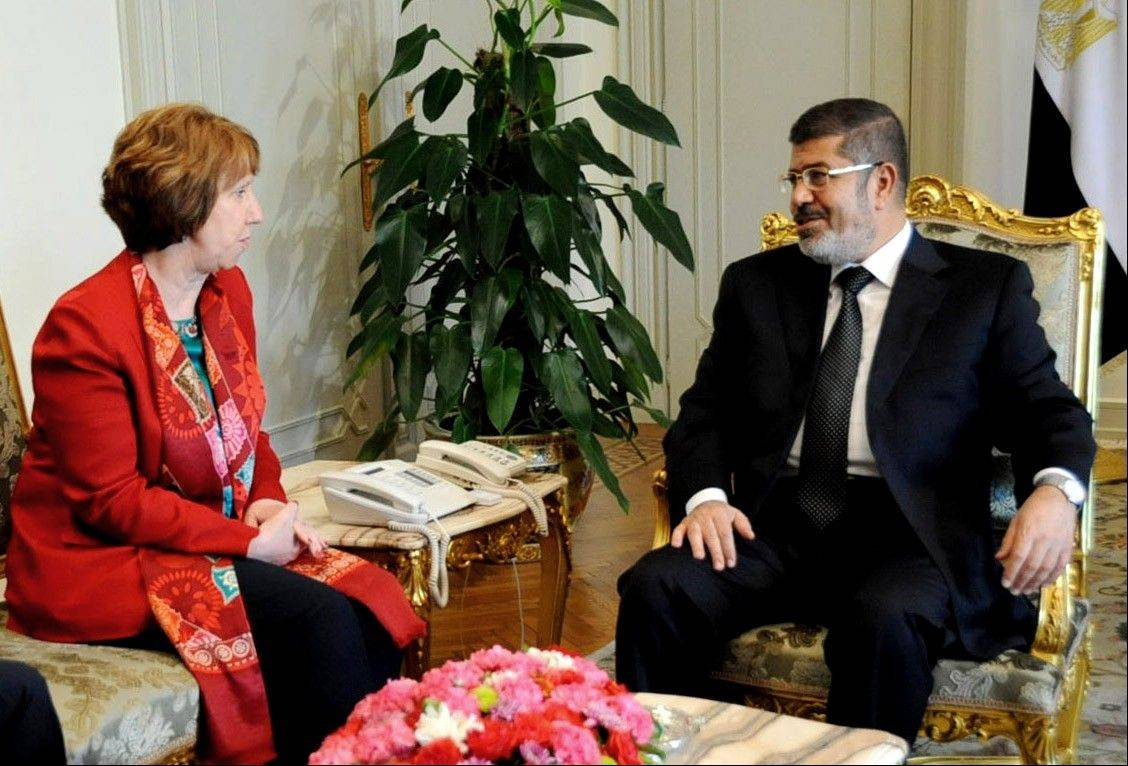 Egyptian President Mohammed Morsi, right, meets with High Representative of the European Union for Foreign Affairs Catherine Ashton, at the Presidential Palace in Cairo on June 19.