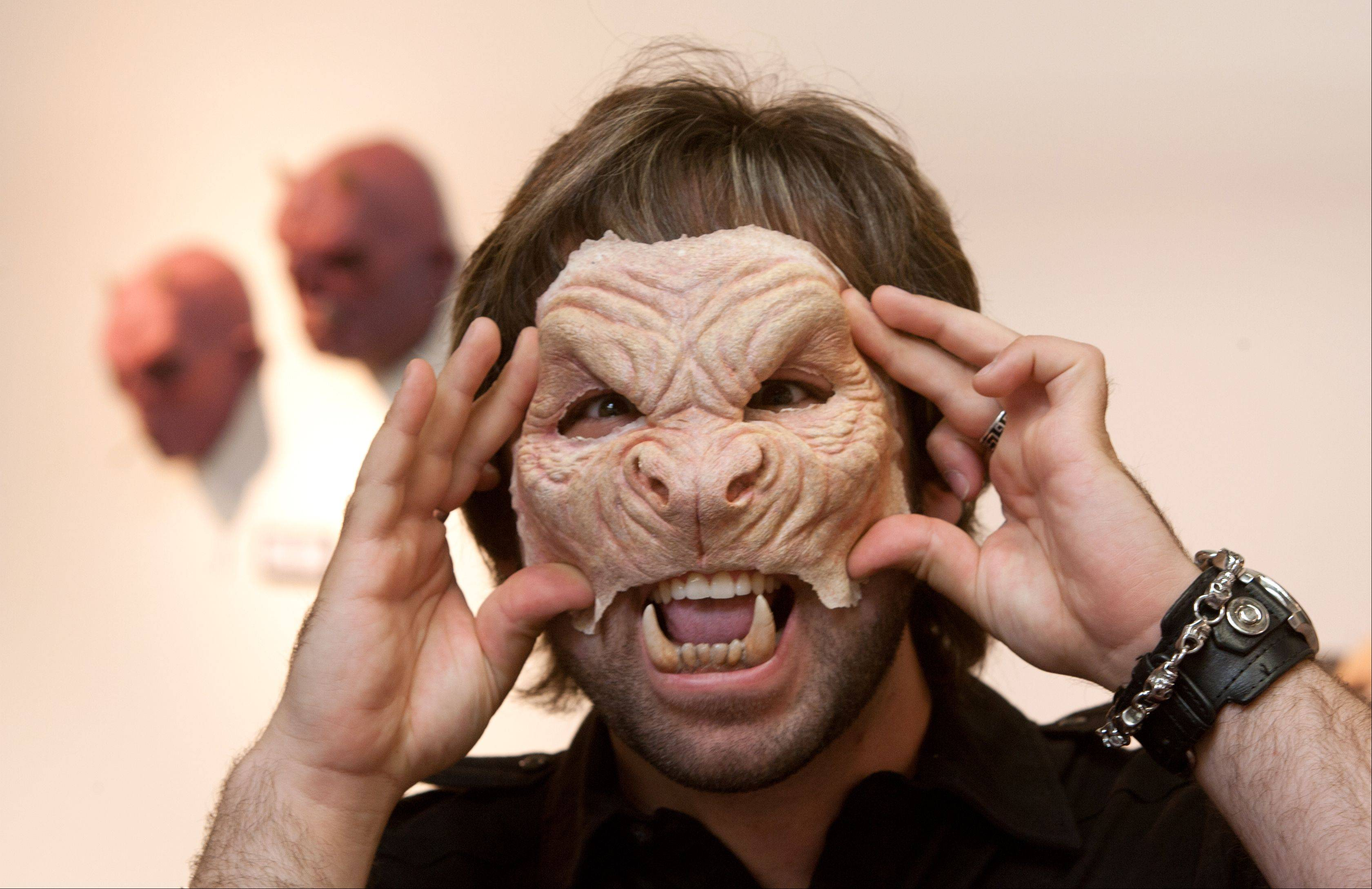 "Special effects artist J. Anthony Kosar, winner of this year's ""Face Off"" competition on the Syfy network, tries on one of his masks."