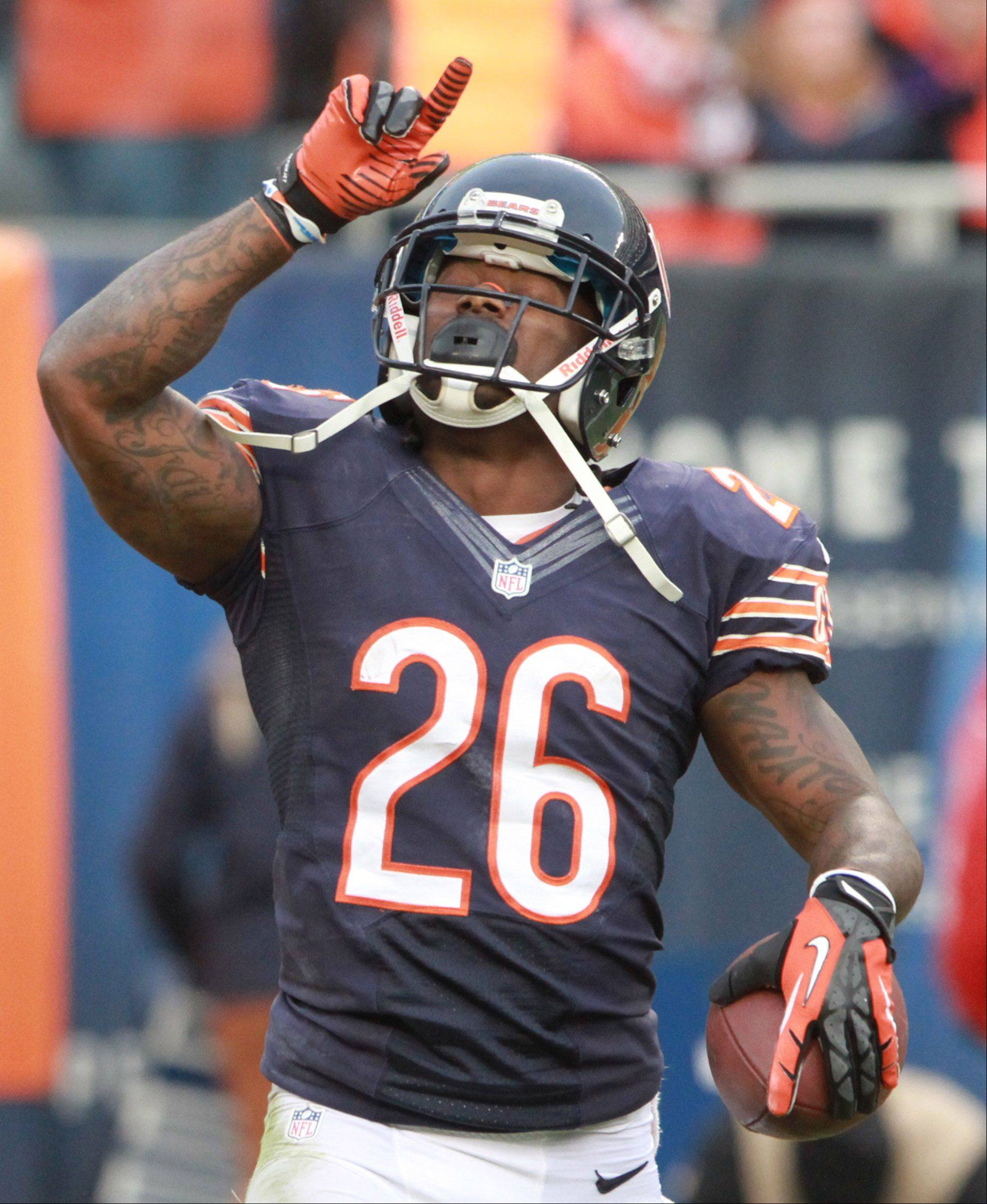 Chicago Bears cornerback Tim Jennings celebrates intercepting a pass by Minnesota Vikings quarterback Christian Ponder.