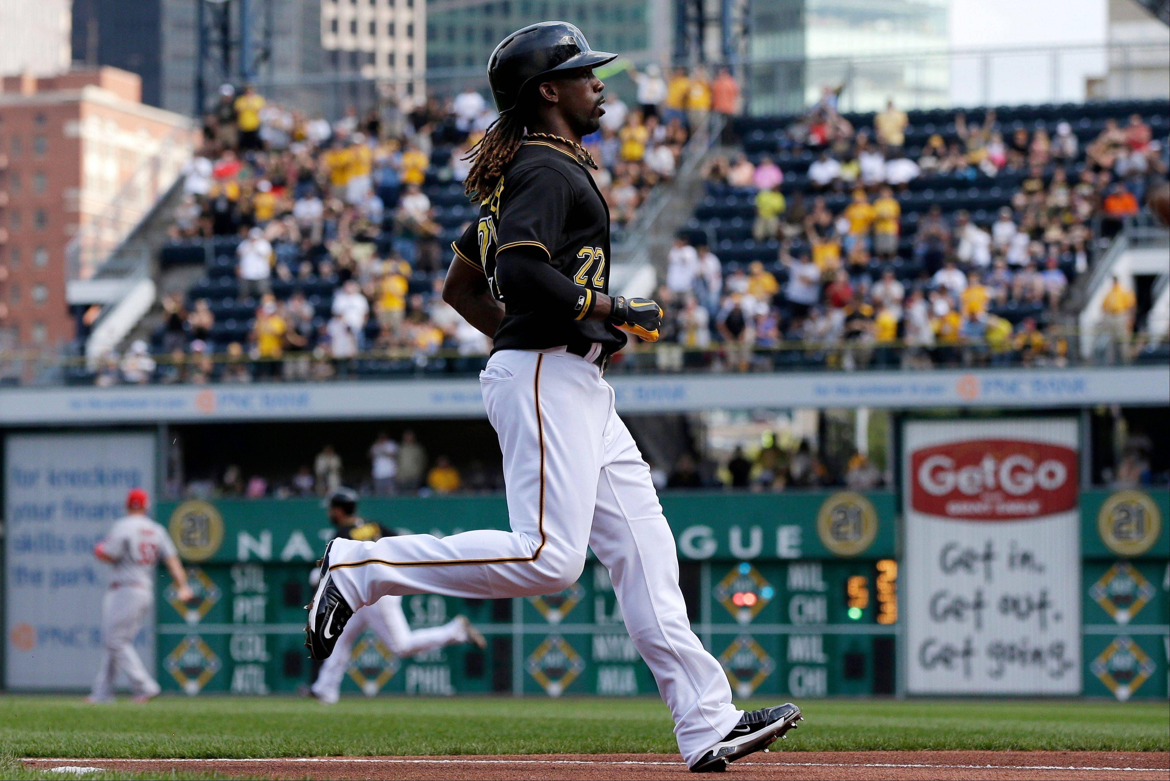 Pittsburgh Pirates' Andrew McCutchen scores on a double by Pedro Alvarez off St. Louis Cardinals starting pitcher Lance Lynn during the first inning of a baseball game in Pittsburgh on Tuesday.