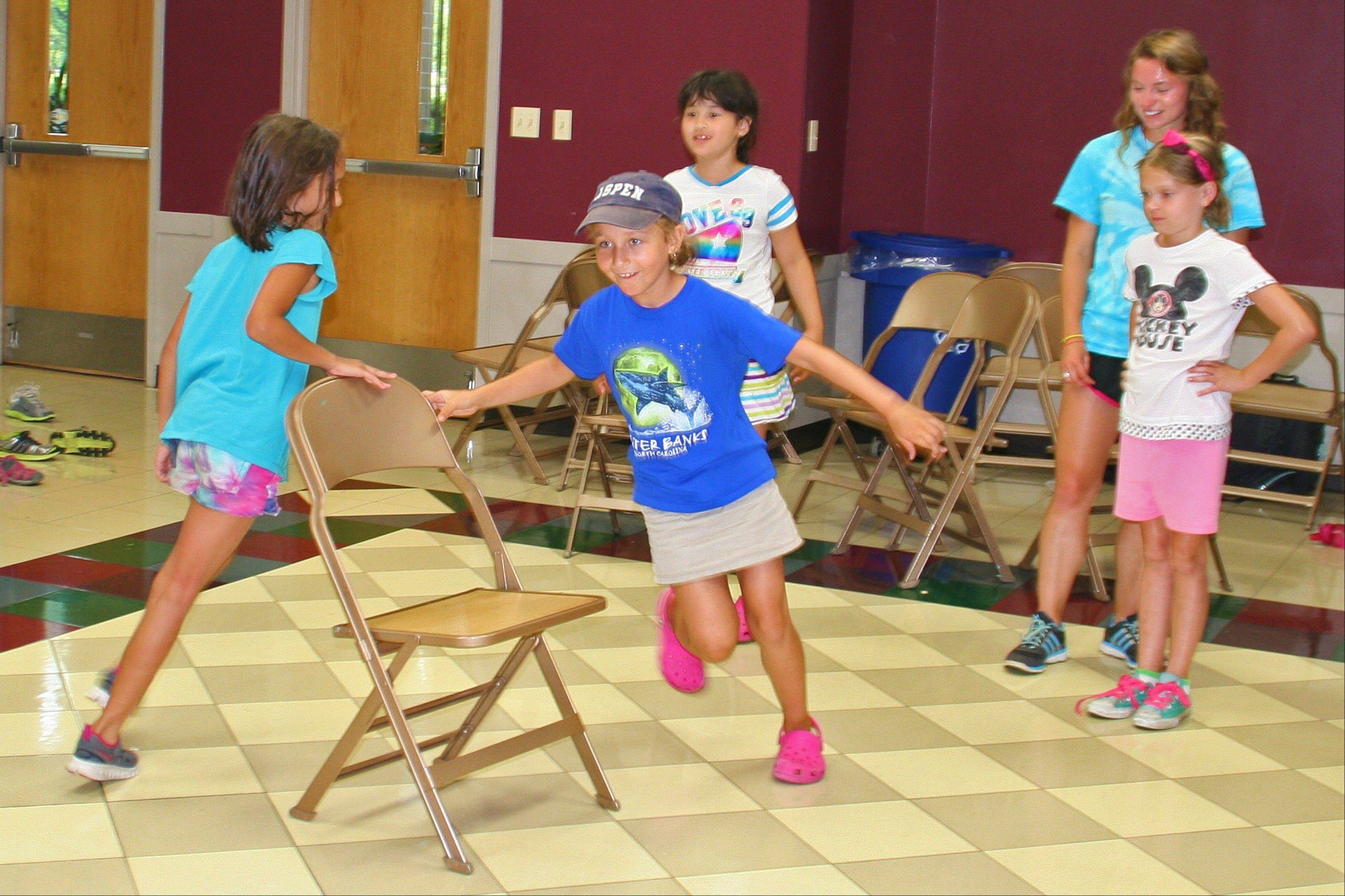 It is down to the final two in a battle of Musical Chairs during the 2013 All Camp Field Day at Prairie Lakes July 17.