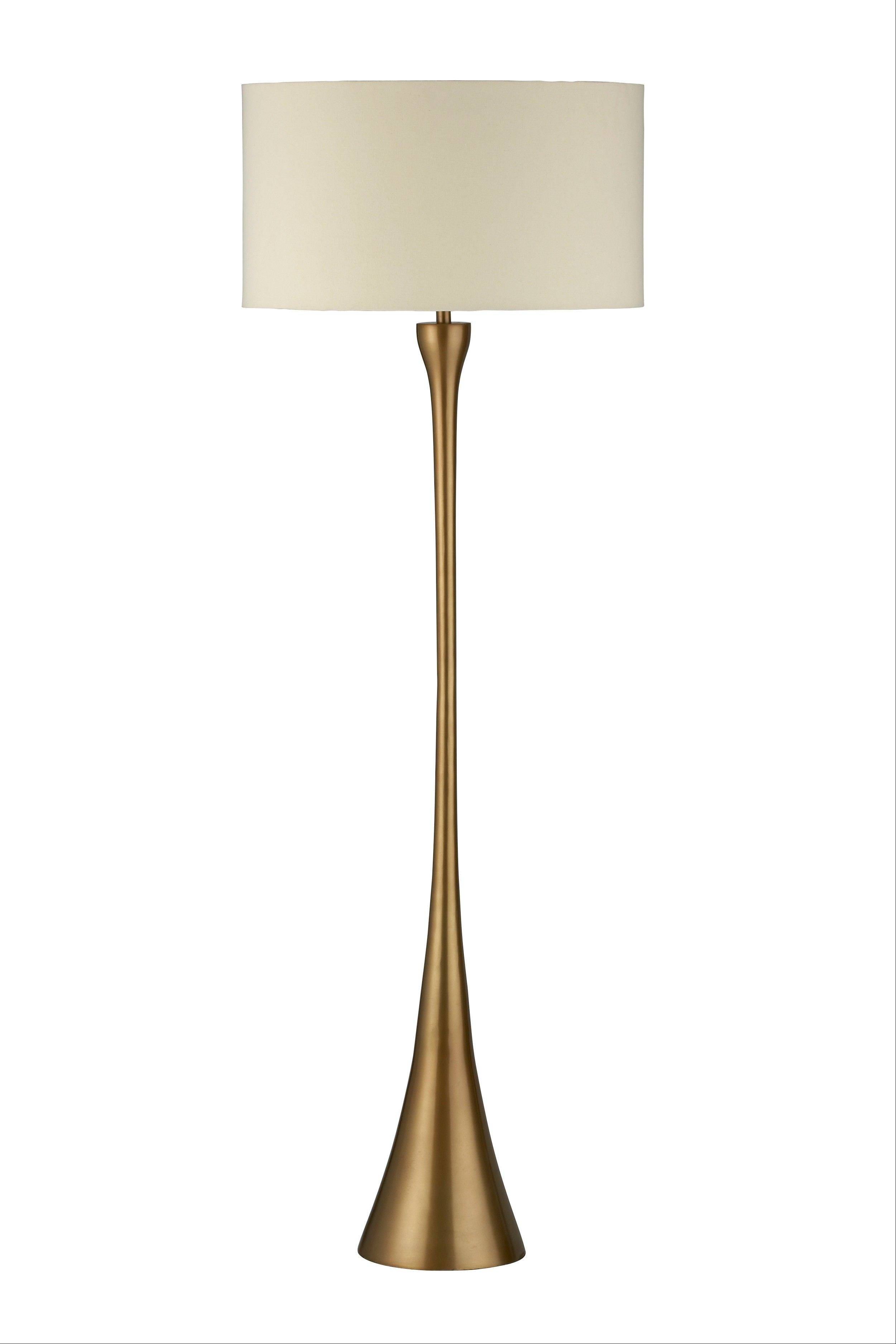 The Melrose floor lamp lights up elongated midcentury curves with an updated matte brass base and a cream canvas drum shade.