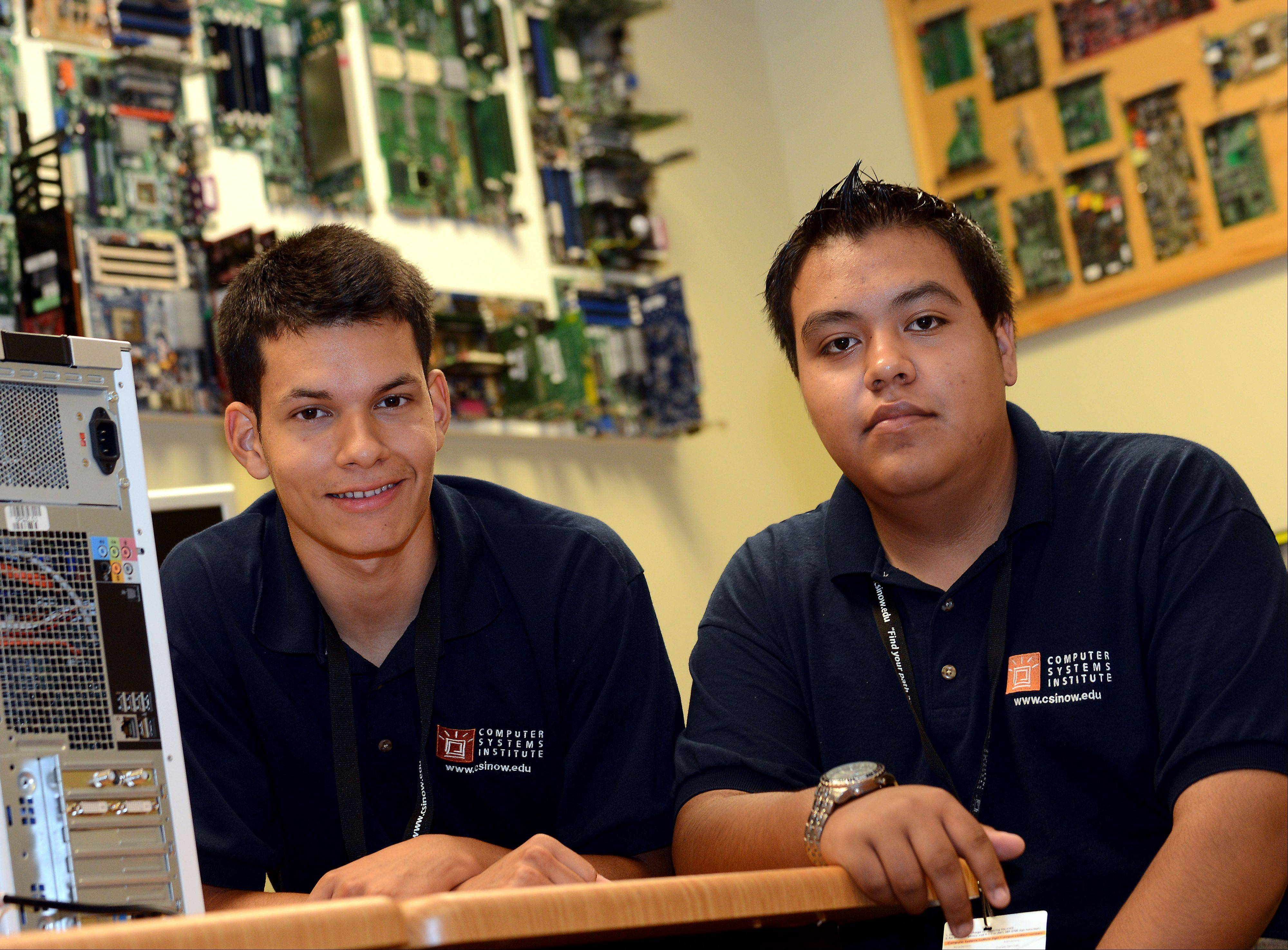 Eduardo Chirinos, left, of Lake in the Hills, and Marco Linares of Elgin, received SMART scholarships from Elgin�s Computer Systems Institute to attend its eight-month computer networking training program. The coursework will prepare them to work in the computer and IT industry.