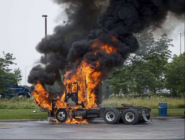 Yow! A truck fully became engulfed in flames yesterday morning in the parking lot of the White Castle restaurant on the corner of North and Gary Avenues in Carol Stream. The truck driver had pulled into the lot after seeing a spark from the engine, and he got out safely.