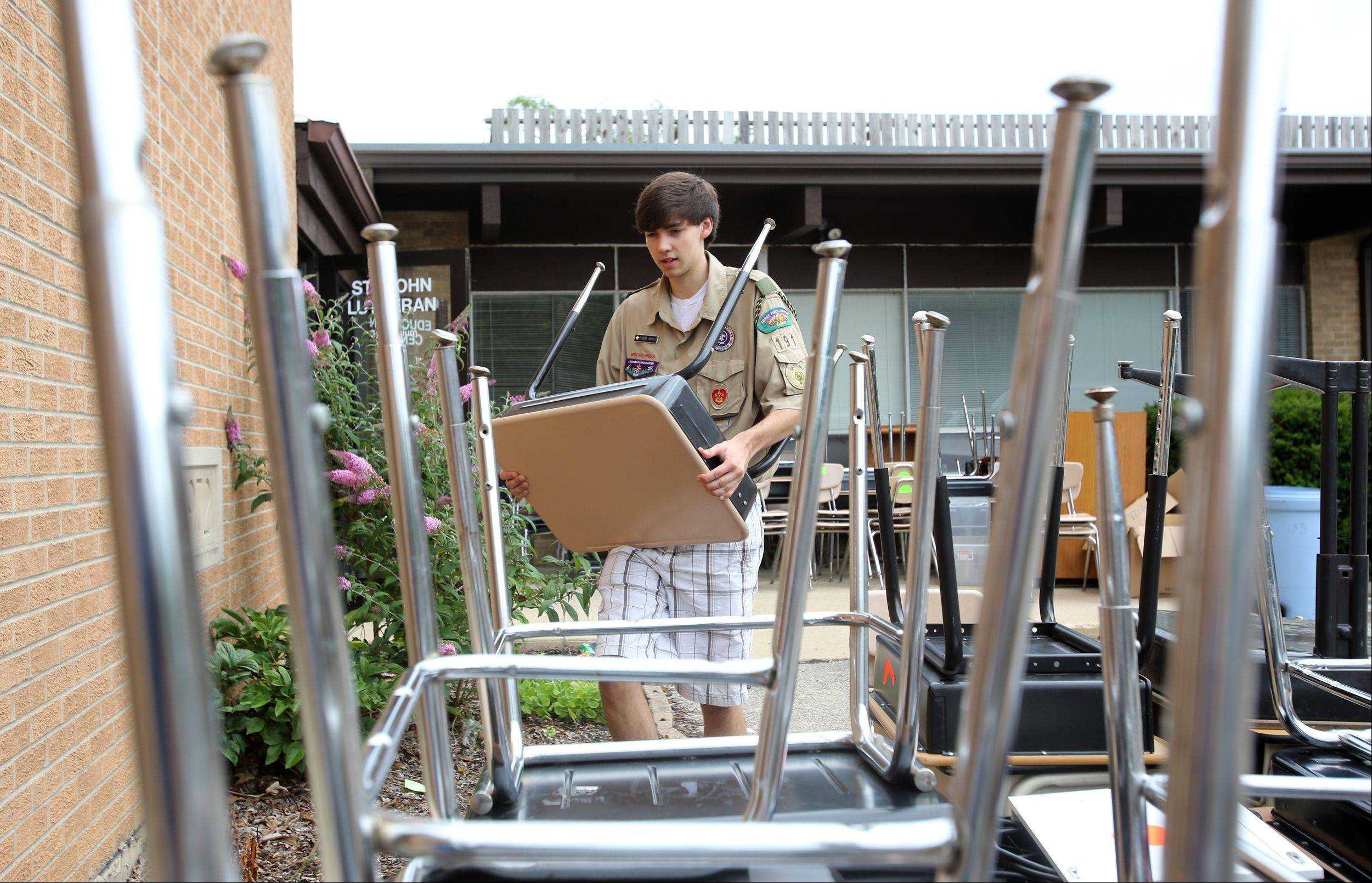 Most of Clare Woods Academy�s desks and furniture have been moved into the new facility at the former St. John�s Lutheran School in downtown Wheaton. Eagle Scout candidate Robert Angiulo, of Troop 191 in Carol Stream, helped with the move over the weekend in preparation for the school�s opening Aug. 22.